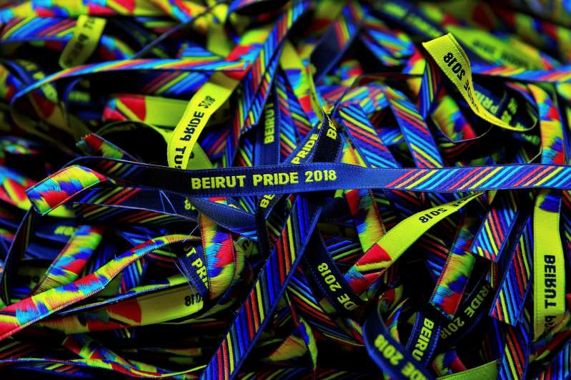 In this picture taken Saturday, May 12, 2018, bracelets decorated with the rainbow colors are displayed at a restaurant during the launch event of Beirut Pride week in Beirut, Lebanon. The organizer of Lebanon's struggling gay pride week has been briefly detained days into the celebrations and the rest of the festival's events cancelled. (AP Photo/Hassan Ammar)