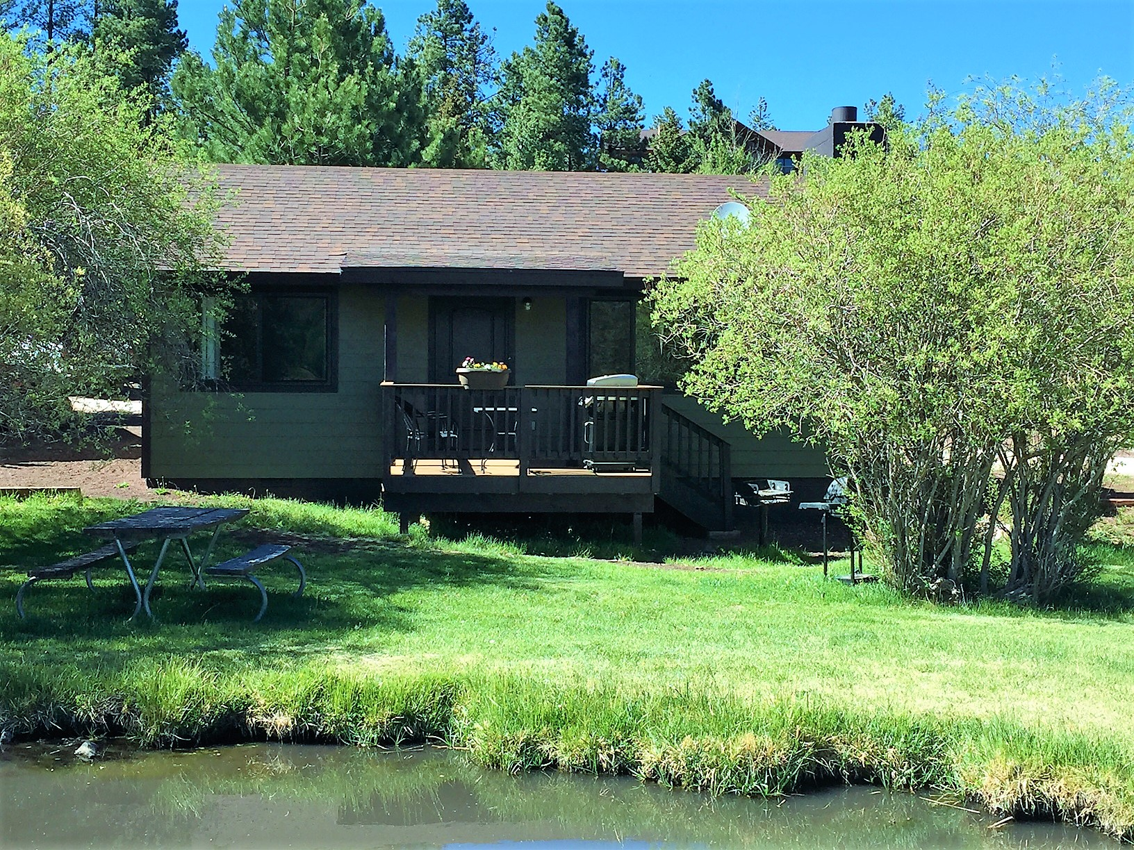 Cabin 3 front elevation with pond.jpg