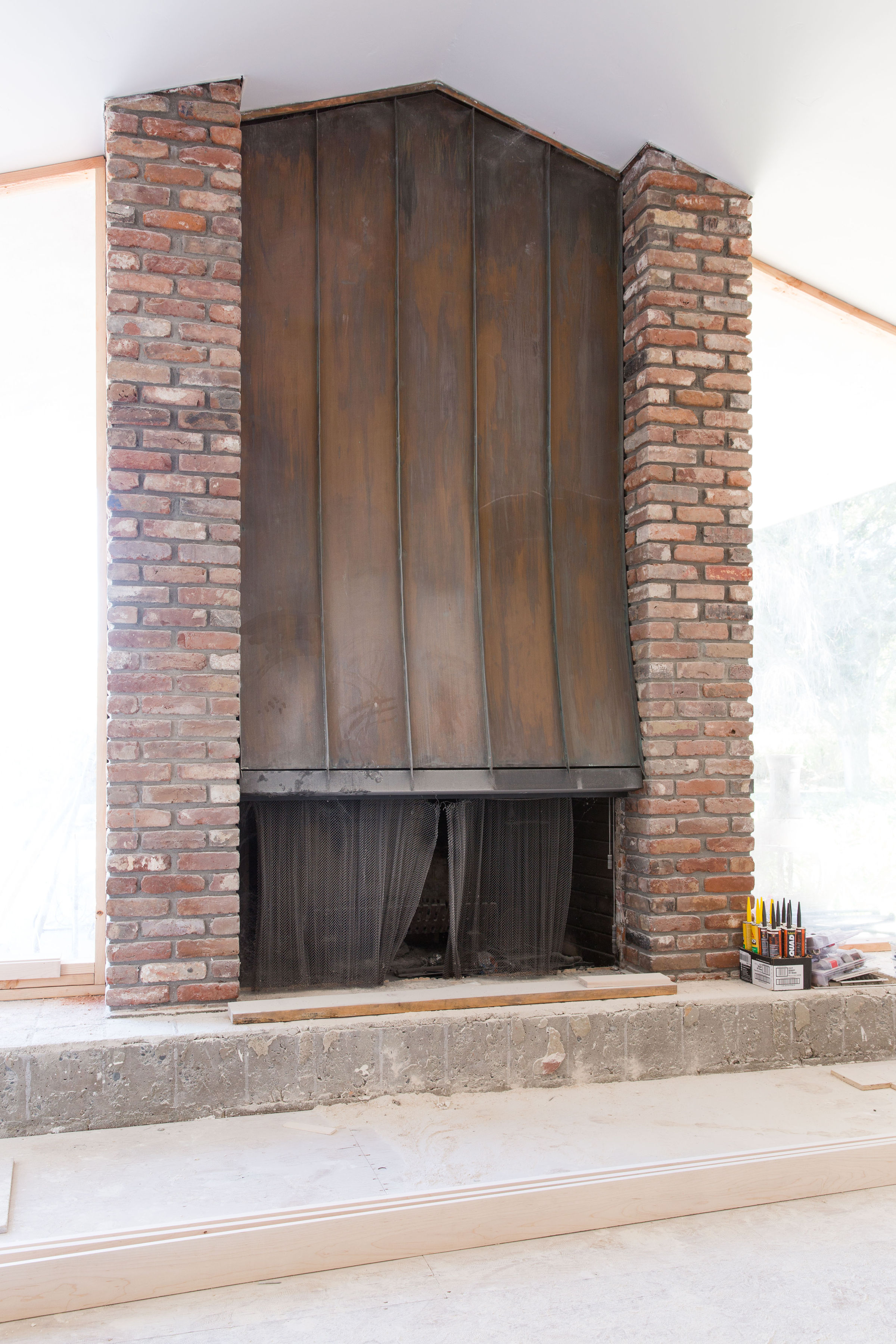 1960'S FAMILY ROOM BRICK & COPPER FIREPLACE