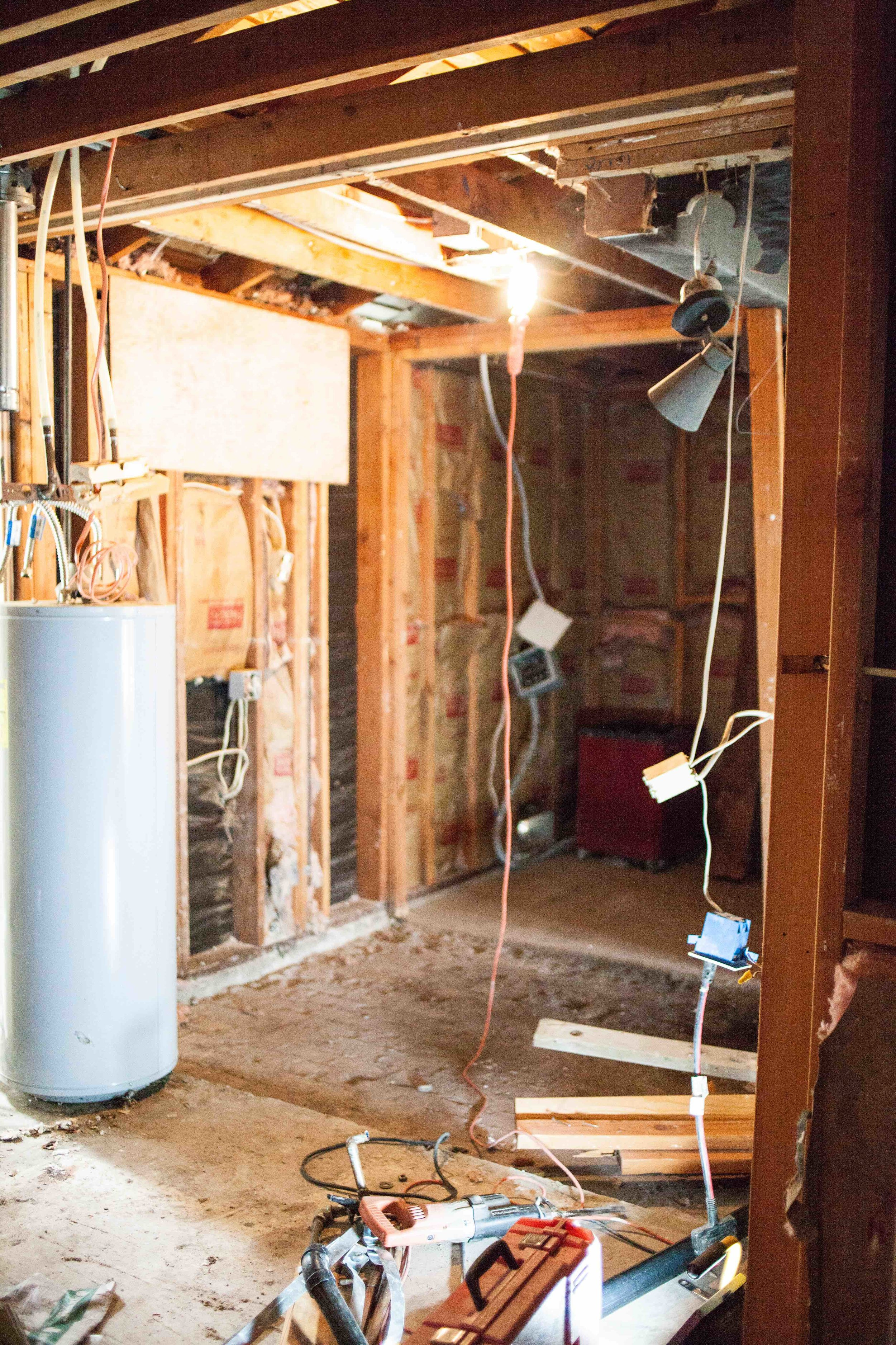 WHAT ARE YOU LOOKING AT?   1.  WATER HEATER : WILL BE REPLACED WITH A TANKLESS THAT WILL BE MOUNTED ON THE EXTERIOR OF THE HOUSE AND THE GAINED SQUARE FOOTAGE WILL BECOME PART OF THE BATHROOM  2.  BACKGROUND: NEW CLOSET SPACE THAT WAS ONCE PART OF THE SAUNA