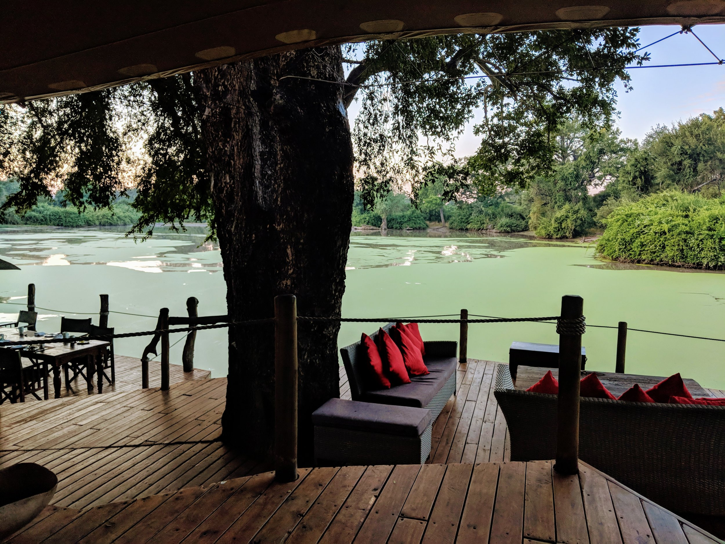 Kanga Camp's reception and dining area set directly upon its lake, the primary watering hole for Mana Pool's animals