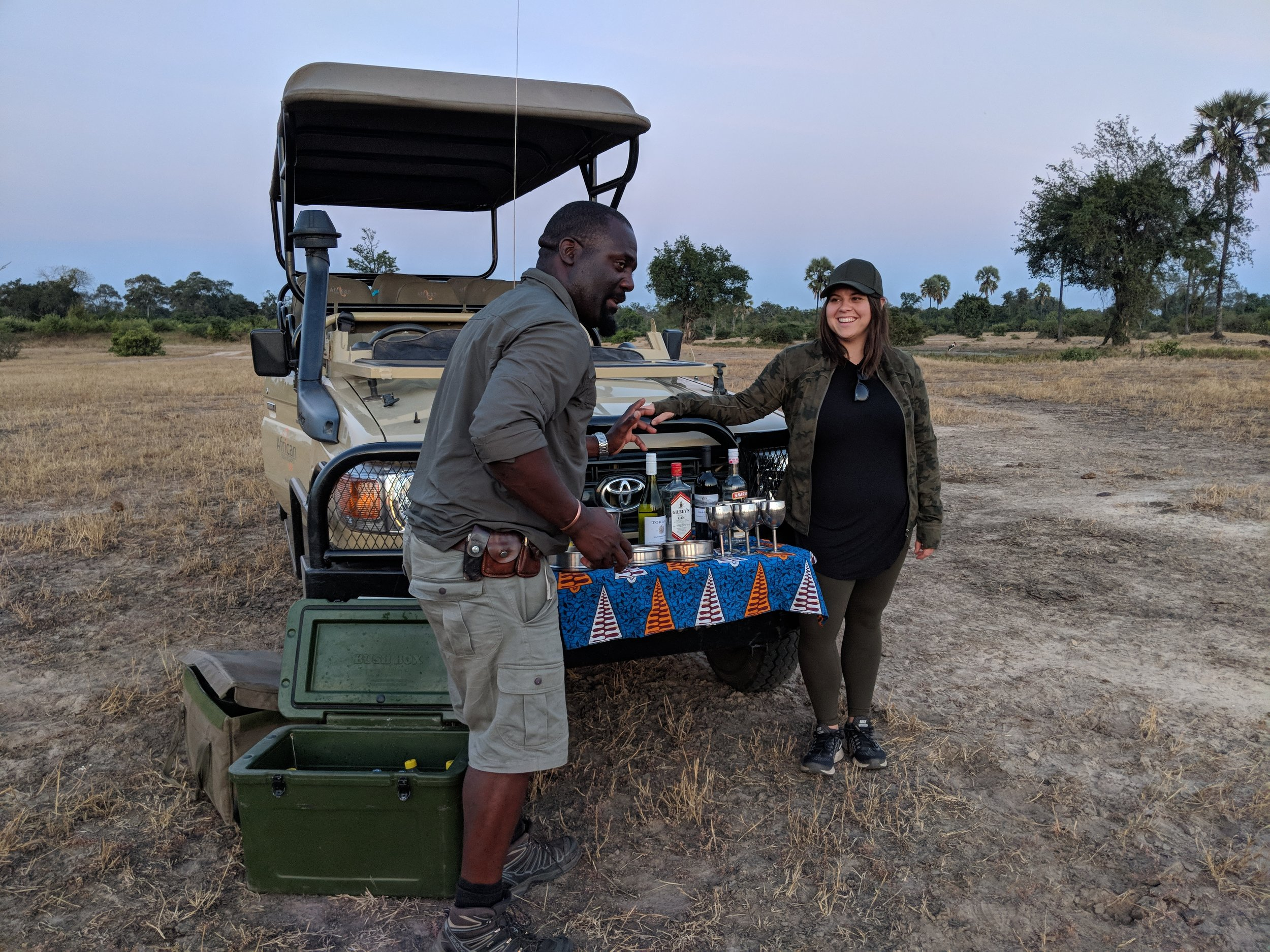 Alf, our favorite guide, setting up our sunset happy hour with the zebras (with some help from my friend, Zeen)