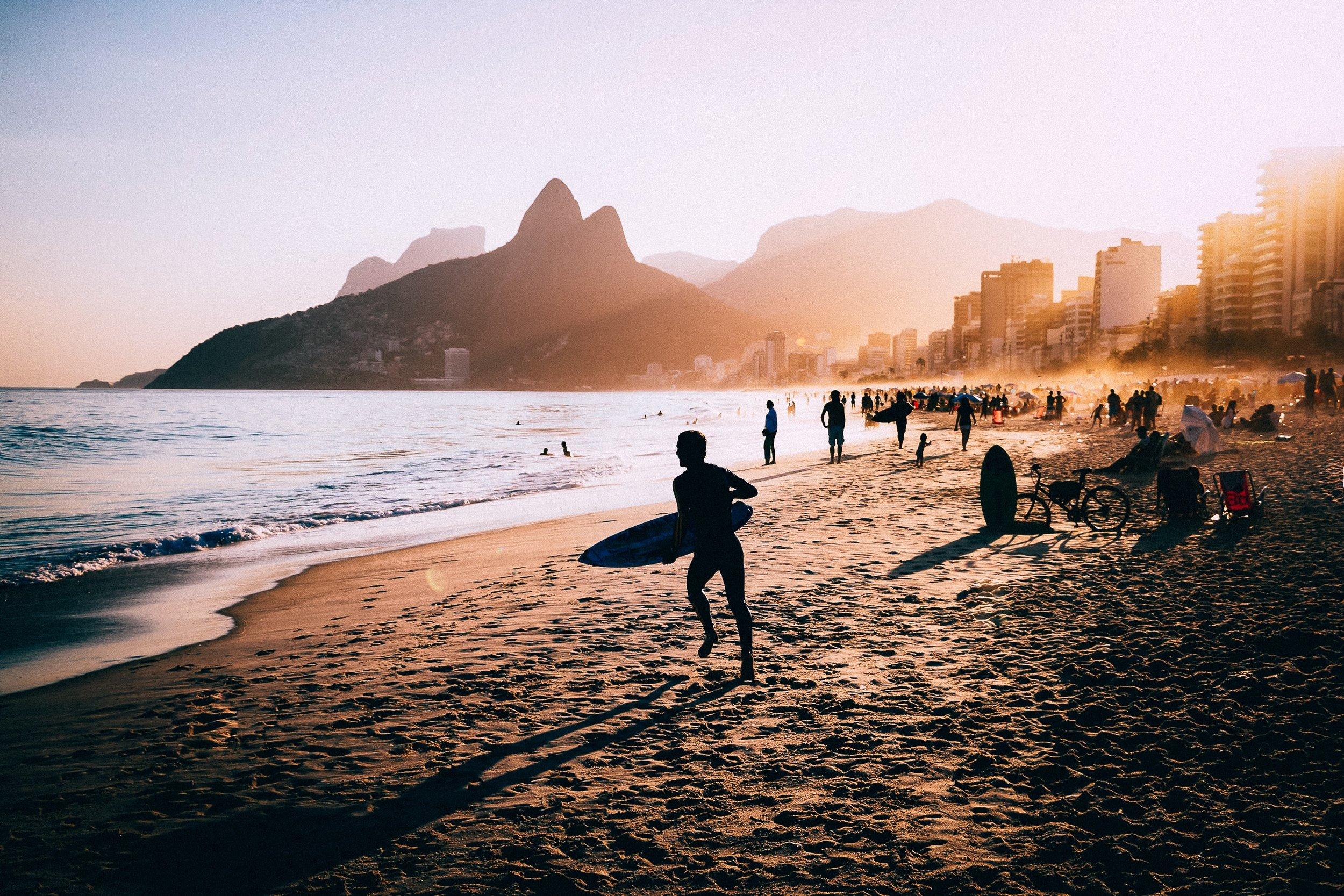 Surfers at Sunset on Copacabana Beach, Rio
