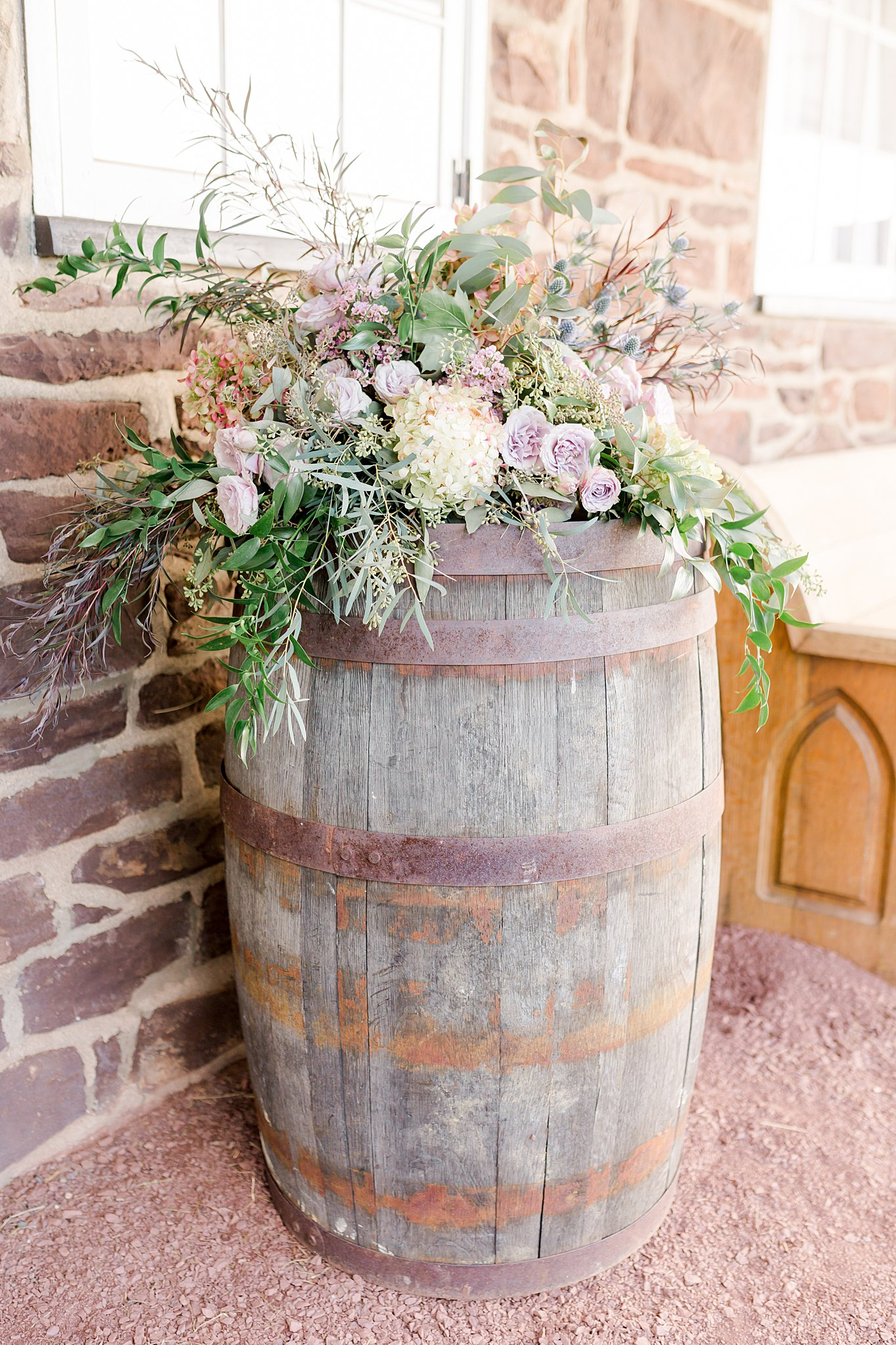 Lush Florals - Nothing says upscale rustic wedding like hand-gathered bouquets tied with flowing silk ribbon or gorgeous trailing table garlands. Floral wrapped trees, fresh swags on ceremony arbors, and pops of greenery are elements that can soften and elevate the rustic charm of your farm venue.