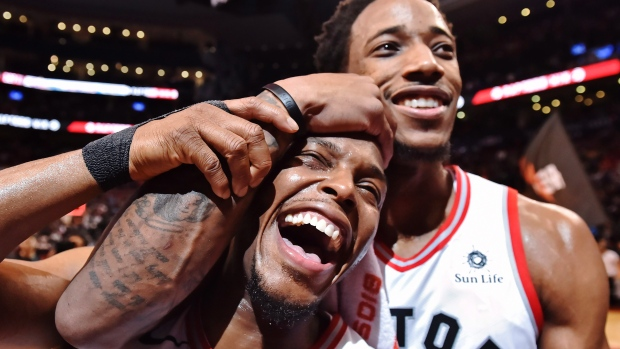DeMar DeRozan and Kyle Lowry celebrating this historic win for the Raptors franchise