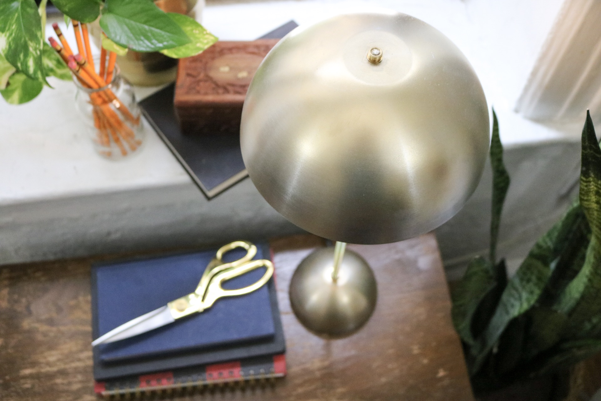 Use bowls from Ikea, a lamp kit and spray paint to create a Mid-Century Modern Lamp!