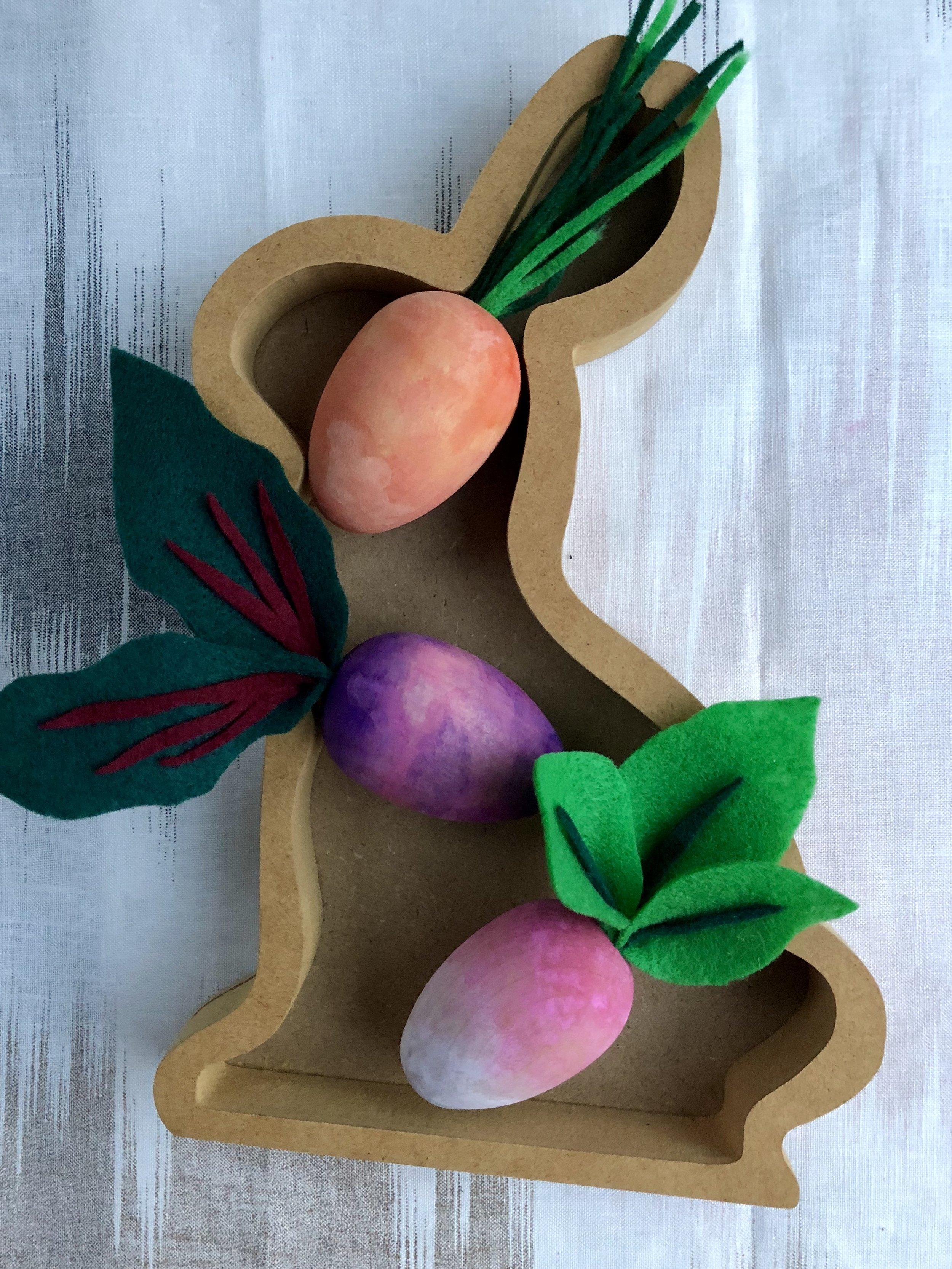 DIY Wooden Watercolor Root Vegetable Easter Eggs #eastereggs #nomesseastereggs #watercolor #easter #easterdiy #easterdecor #easterdecorations #woodeneastereggs #woodcraft #craftsforkids #easycrafts #springcrafts #vegan #rootvegetables #vegetables #eatyourveggies #veggies