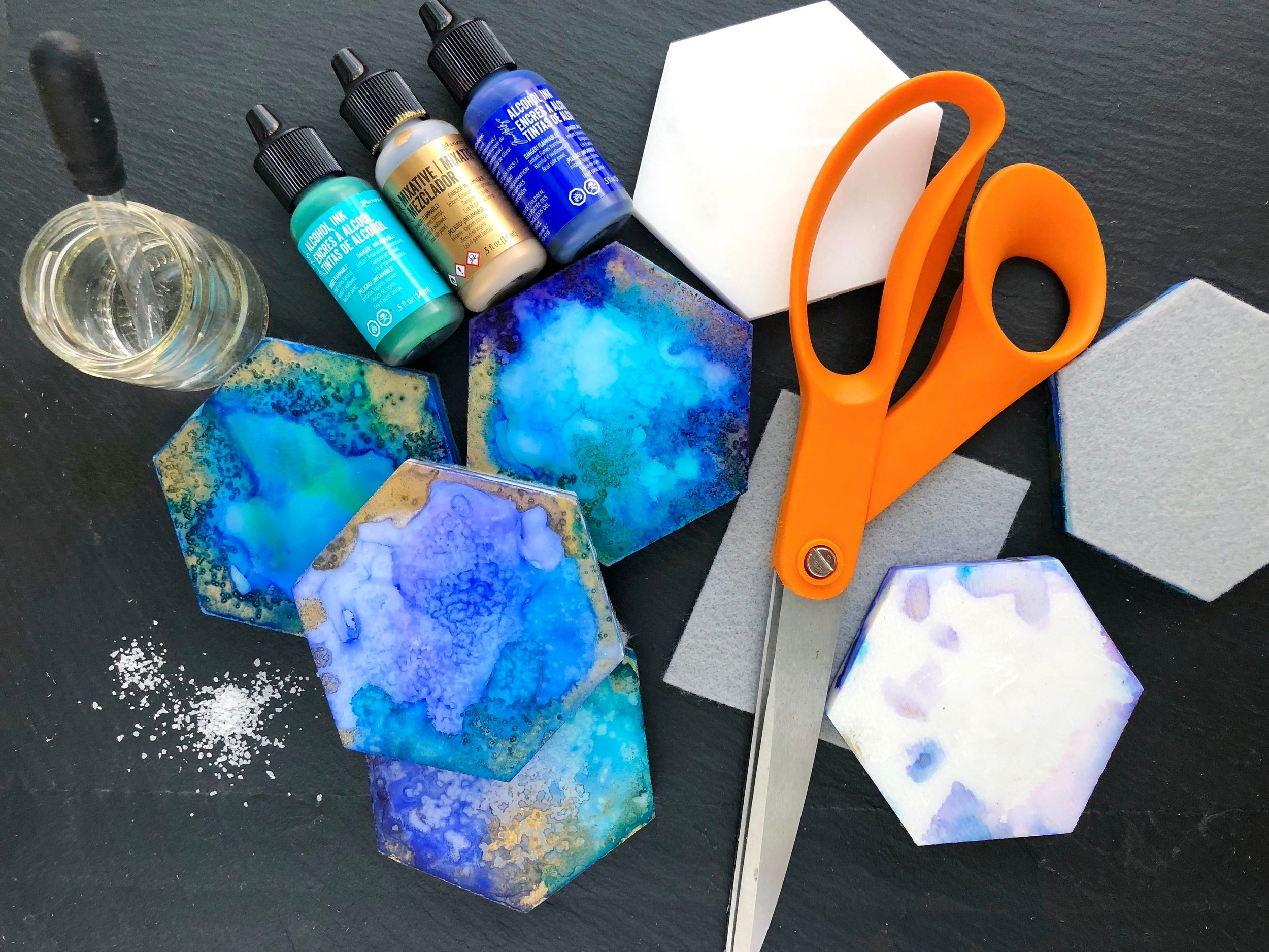 DIY Alcohol Ink Hexagon Tile Coasters #diycoasters #homedepot #alcoholink #alcoholinkcraft #summercocktails #summerdiy #marblecoasters #coasters #coastersdiy #diycrafts #craftstodowhenyourebored #rubbingalcohol #homedecor #homeentertaining #coffeetable