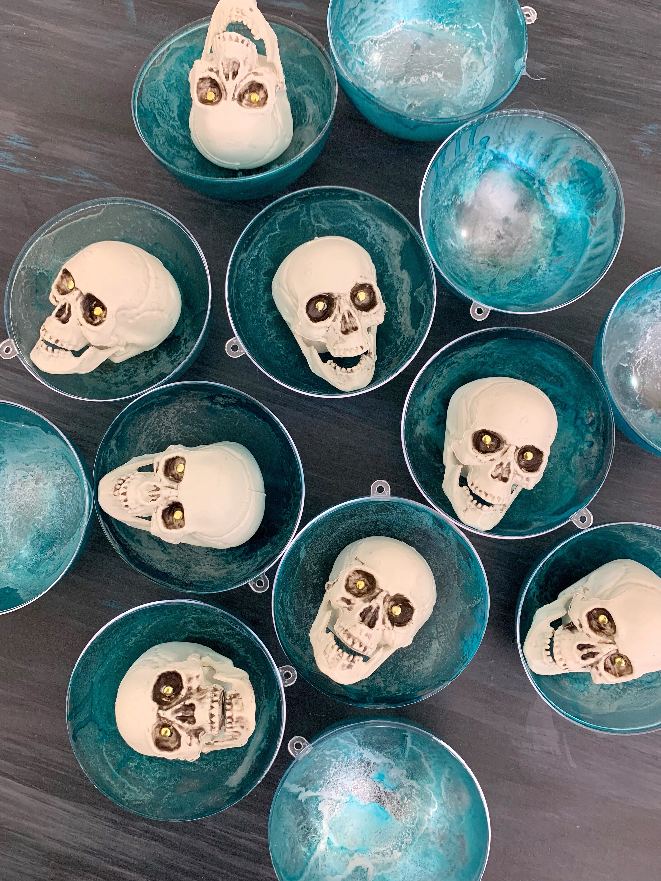 DIY Alcohol Ink Crystal Ball Ornaments - Create a mystical light up crystal ball with a glowing skull inside.  #HalloweenTree #treetopia #HalloweenOrnaments #FortuneTellerDecor #VintagePsychicDecoration #TarotCards #psychic #psychicmedium #fortuneteller #palmreader #Paranormal #crystalball #skull #Halloweencraft #lightupskull #howtoalcoholink #halloweendecorations #halloweendecor