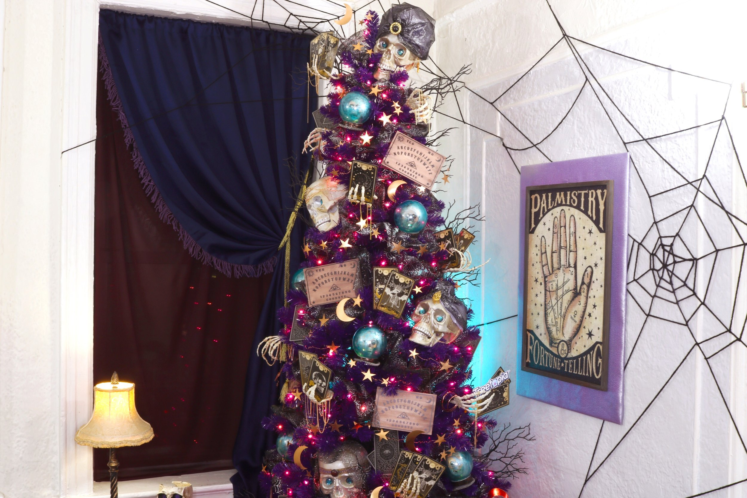 Psychic Fortune Teller Halloween Tree Diy and Treetopia Giveaway! #Halloween #Halloweendecor #halloweendiy #hauntedhouse #halloweentree #halloweenornamnets #psychic #fortuneteller #mystical #treetopia #halloweengiveaway #halloweenchristmastree #notsospookyhalloween #skeleton #fortune #vintagehalloween #purpletree #TreetopiaScaryRooms #TreetopiaHalloween #TreetopiaScavengerHunt