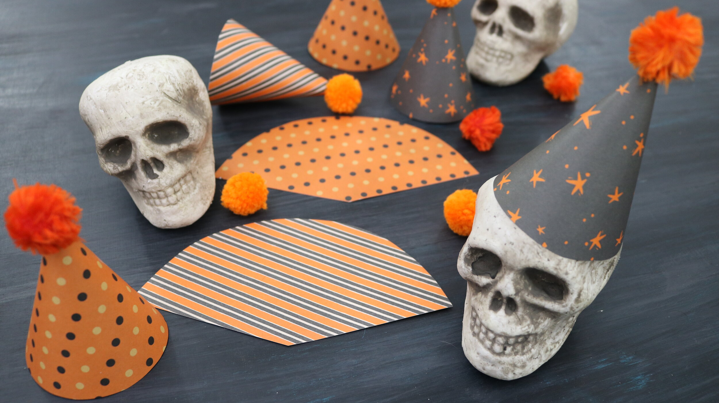 DIY Skull Garland Halloween Birthday Party  With a few simple materials, you can make a one-of-a-kind birthday garland with a huge impact that will be sure to fright and delight your party guests! They're dying to celebrate you!  #halloweendecorations #halloweendecor #halloweendiycrafts #birthdayparty #octoberhalloween #easyhalloweendiy #cuteandcreepy #madebymichaels #michaelshalloween #evite #partyinvitaions #halloweeneveryday #easygarlanddiy
