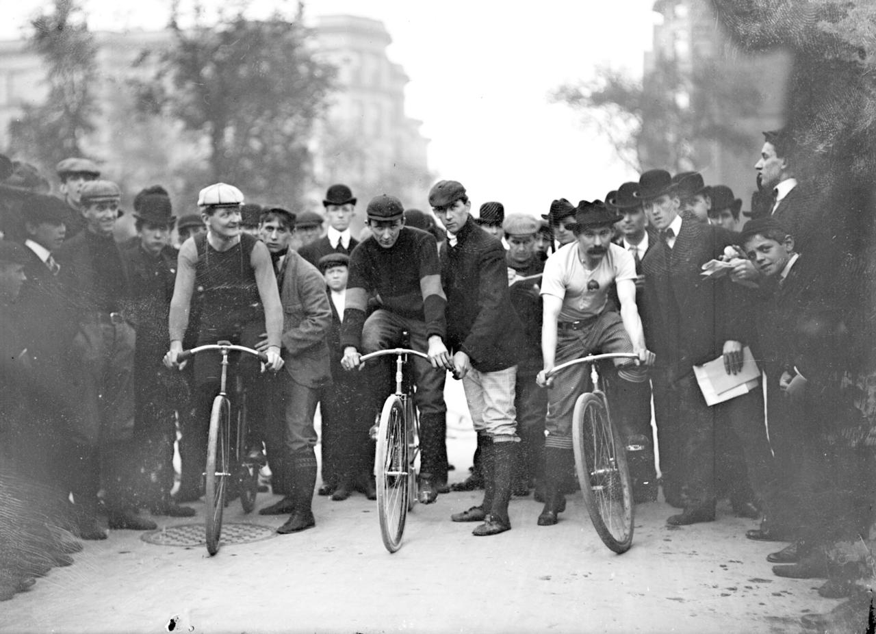 Cyclists J. E. Gill, C.A. Linde and Ed Bukowski, position their bicycles in front of a crowd on North Michigan Avenue in Chicago in 1901.   —  Chicago History Museum , Jan. 1, 1901