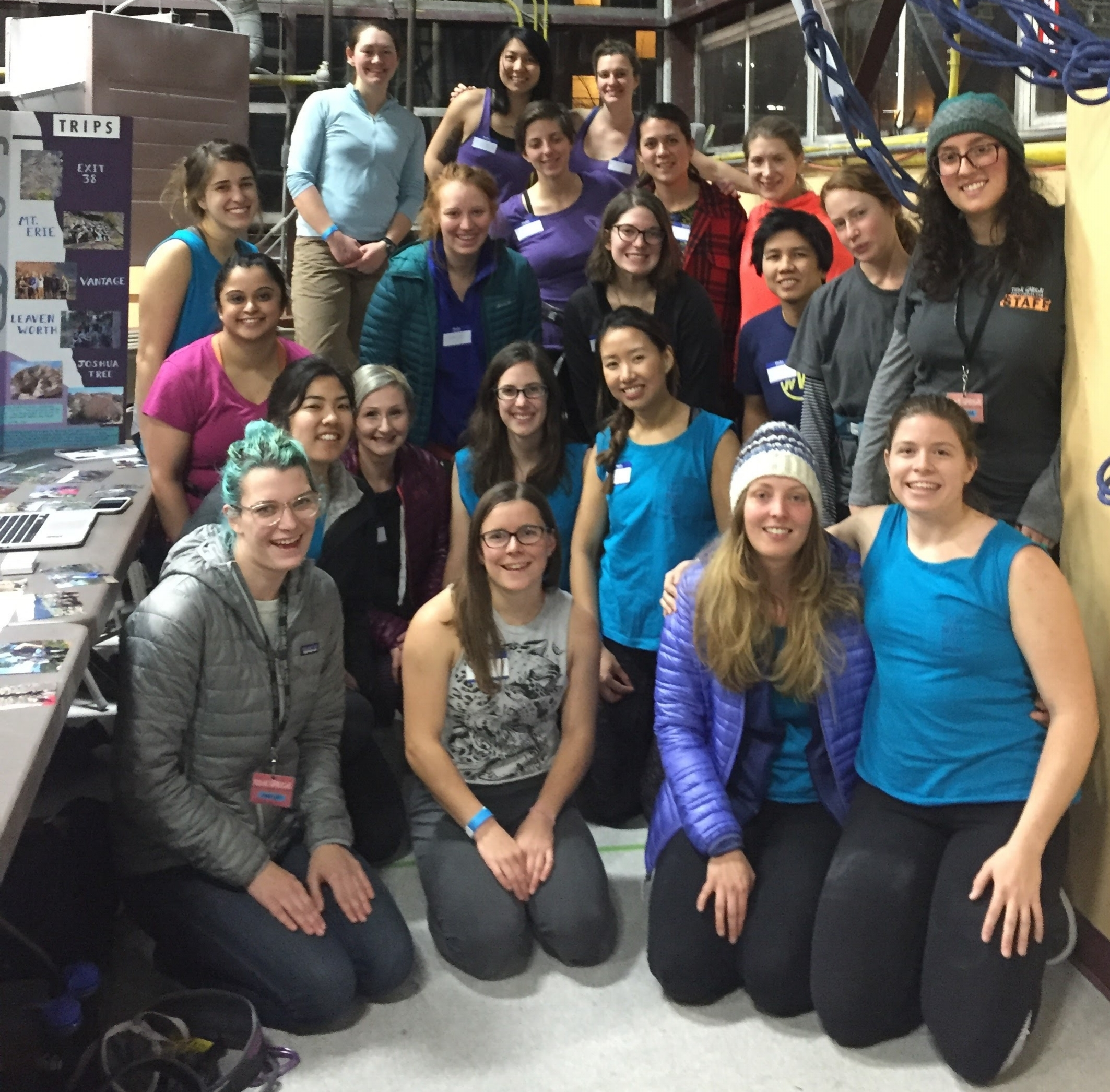 The group of volunteers from Never Stop Moving, Alpenglow Collective and She Rocks joining together before embarking downstairs to belay new climbers and provide bouldering guidance to motivate more women to feel comfortable and excited about climbing in a gym.