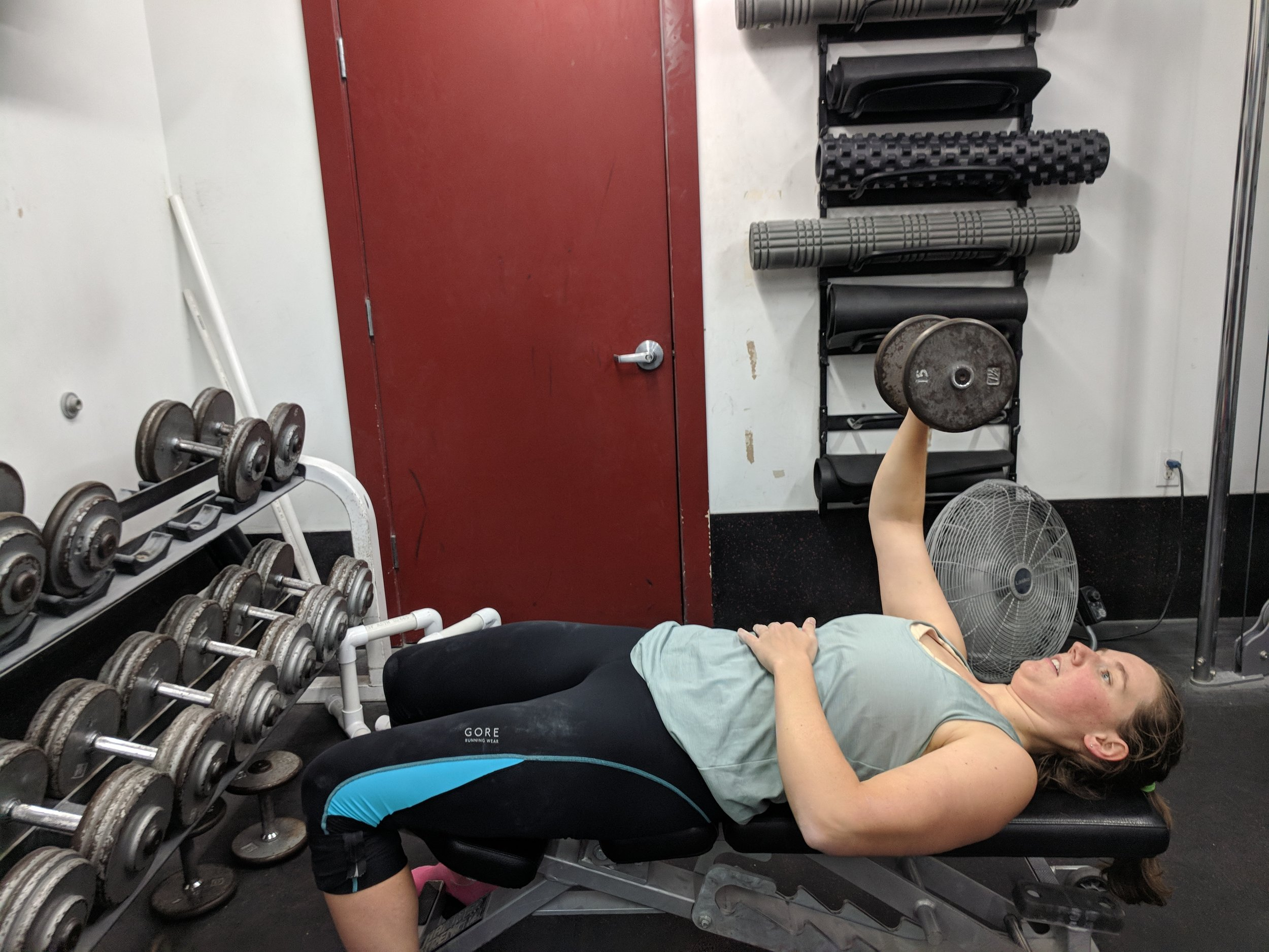 Claire completing some bench presses during the strength phase circuit at Stone Gardens in Seattle, WA. Photo by Megan Fritz