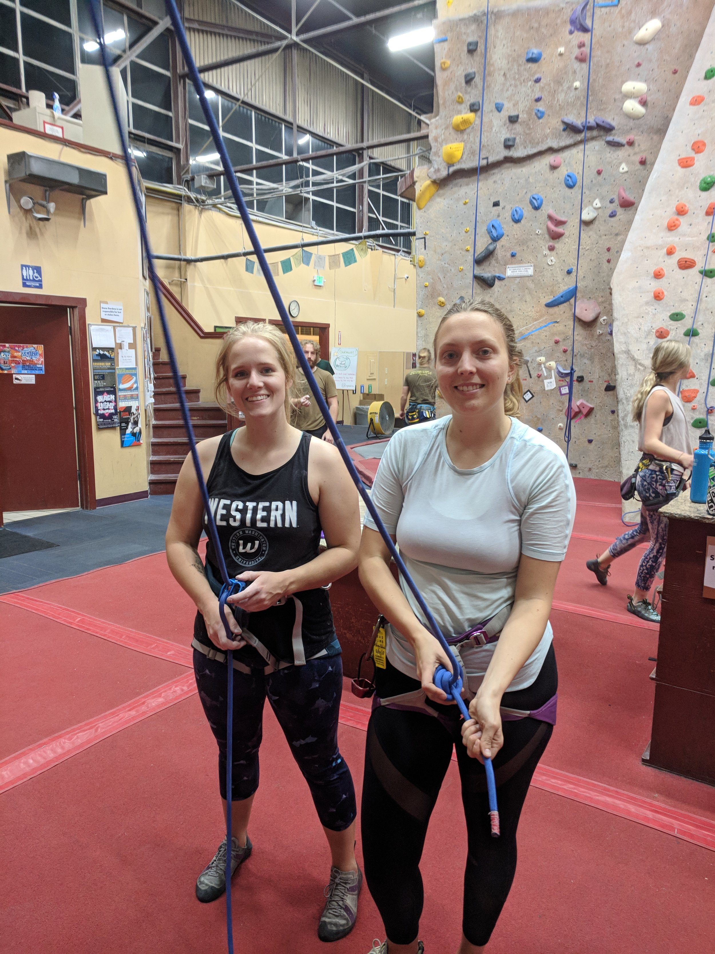 Kayla and Stefanie climbing together during a Training For Climbing Club night after performing their active stretches! Photo by Megan Fritz