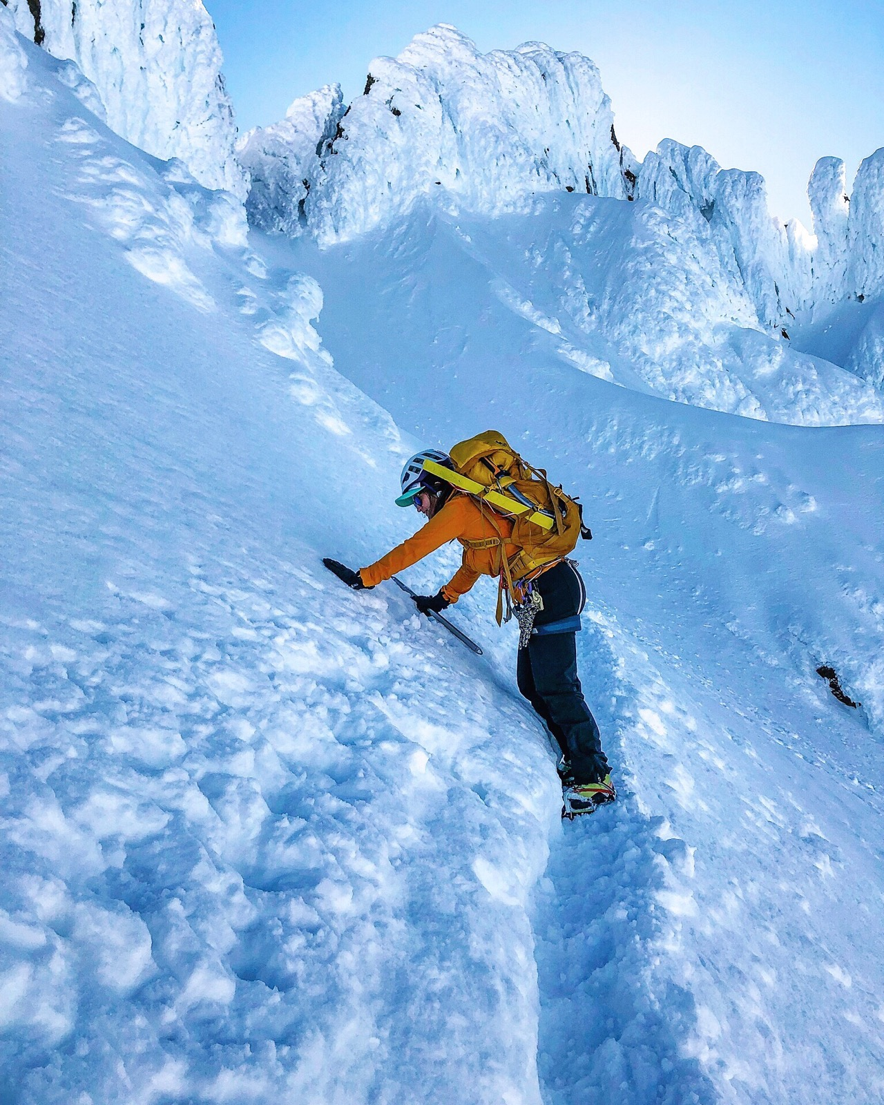 NSM member Kelsey Graner working her way across a steep snow slope to get to the summit of Mount Hood