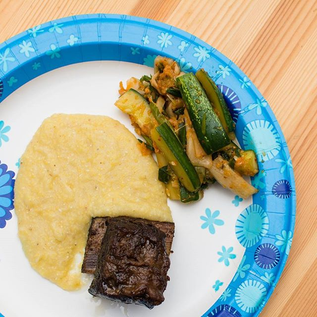 #paperplatelife 😂 Sunday night feast for neighbors and friends.  24 hr sous vide short rib in a soy ginger marinade, glazed with reduced jus and finished under the broiler. Served over coconut milk polenta with Korean marinated cucumbers.