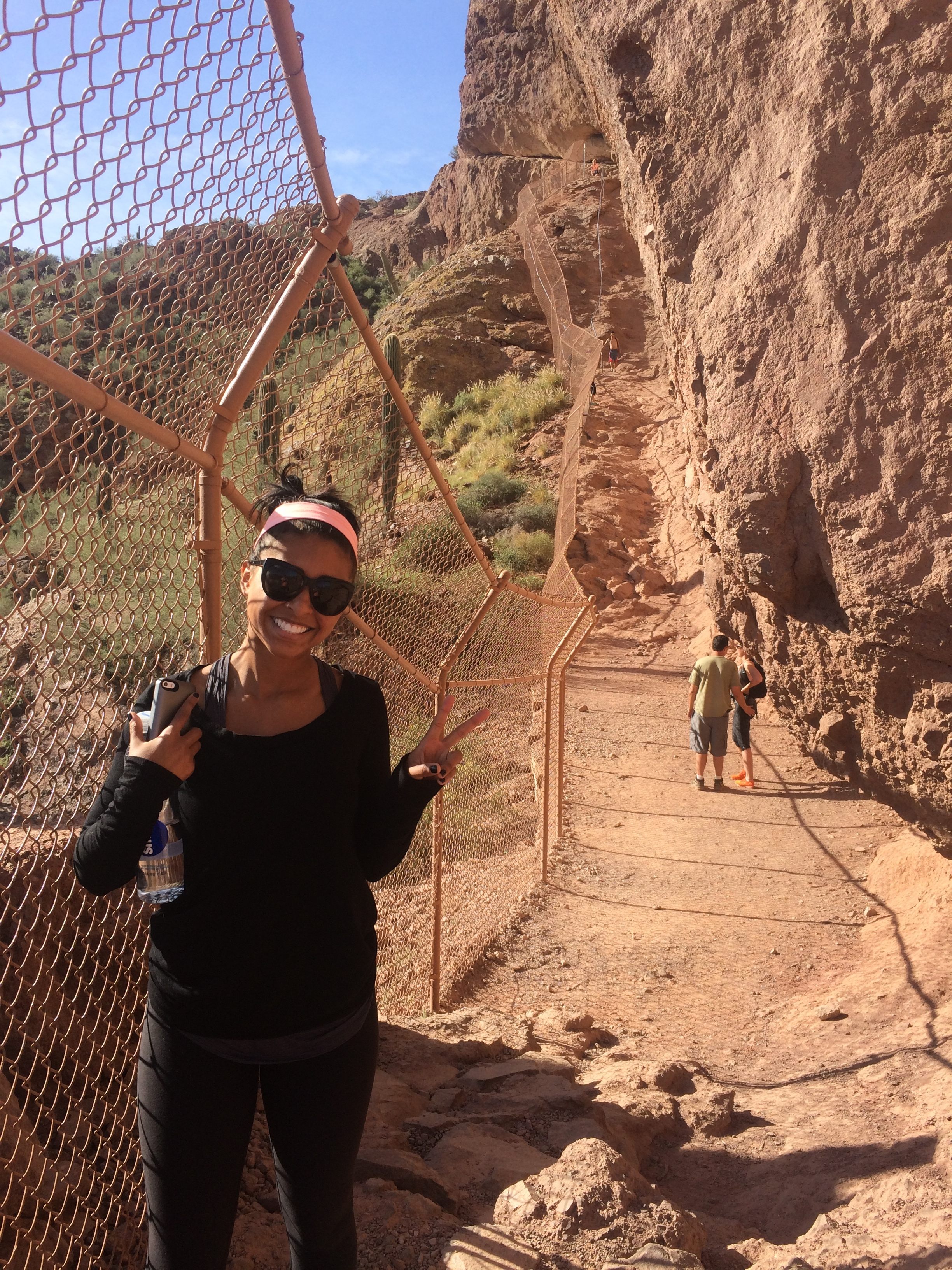 Spring Training. Photo taken right before I realized that Camelback mountain is an actual mountain, and camelback backpacks are named after this sucker for a reason. That hiking experience is not only reccommended for such a mountain as this, it is required if you don't want to almost die.Also, this is right before I considered being air lifted down. See that girl. Her smile is proof that she is a niave young duck. The only thing that kept her from the emergency airlift was her aunt reminding her that it would likely make the news. And the entire Texas Rangers team would not let her live this one down.  For the record, I survived. And this is not a hike. It is a full fledge Climb to the Heavens. And that stair case is not-a-joke. Object appears smaller through this photograph. Do Not be fooled.