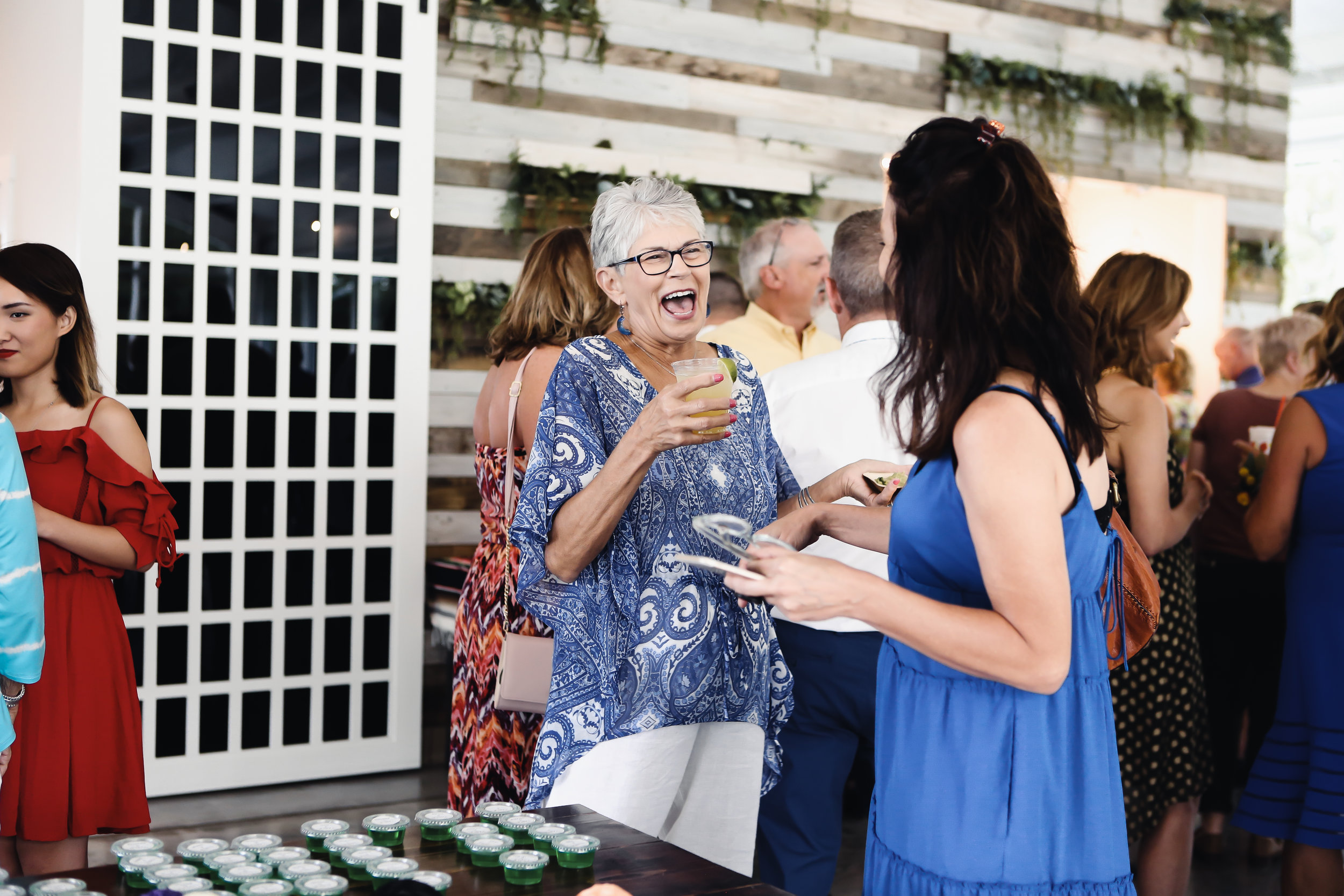 Natalee and Felicia's guests have fun celebrating at Greenhouse Two Rivers since their wedding planner took care of all the details.