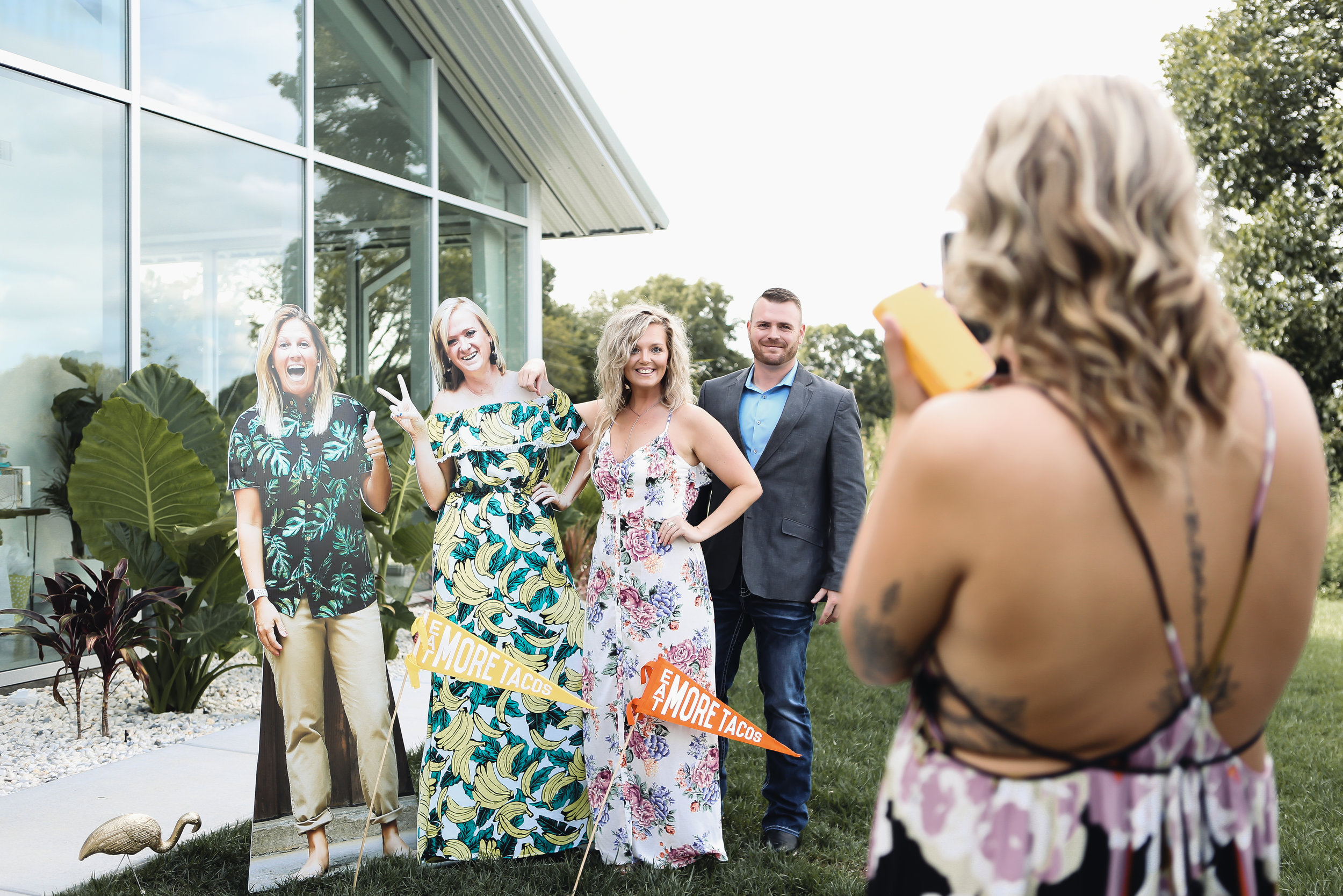 Natalee and Felicia's guests have fun taking photos of their cut outs since their wedding planner took care of all the details.