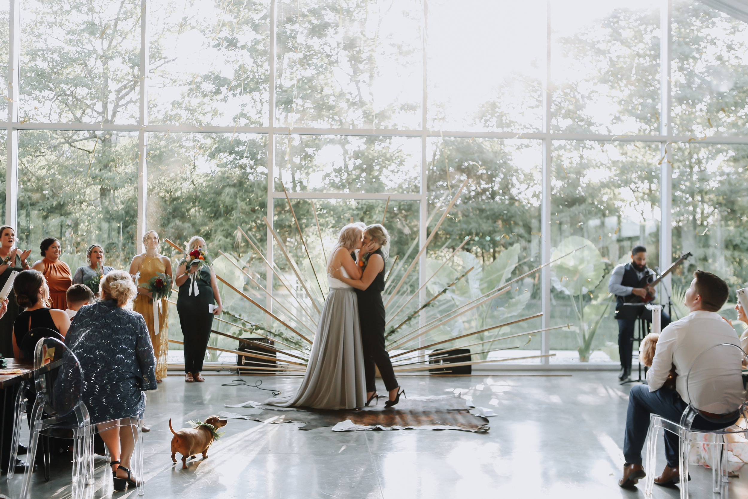 Natalee and Felicia have fun celebrating with their family and friends since their wedding planner took care of all the details.