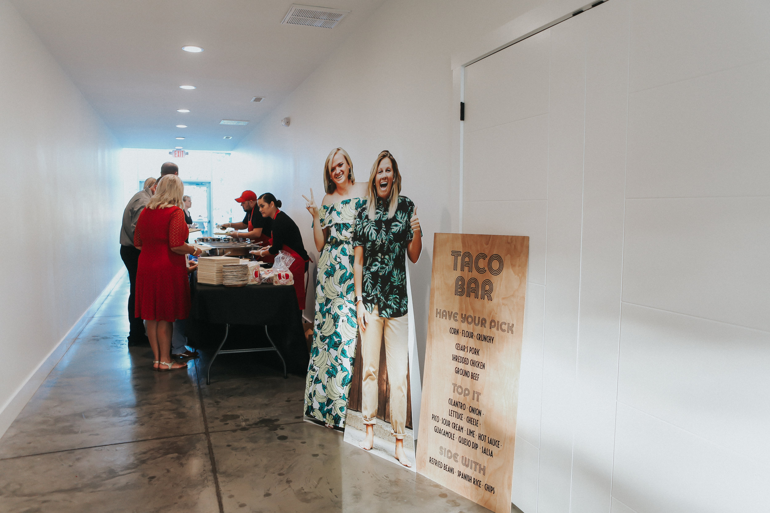 Natalee and Felicia's wedding coordinator worked with their favorite restaurant, Cesar's Old Mexico to serve a custom taco bar at their Greenhouse Two Rivers wedding.