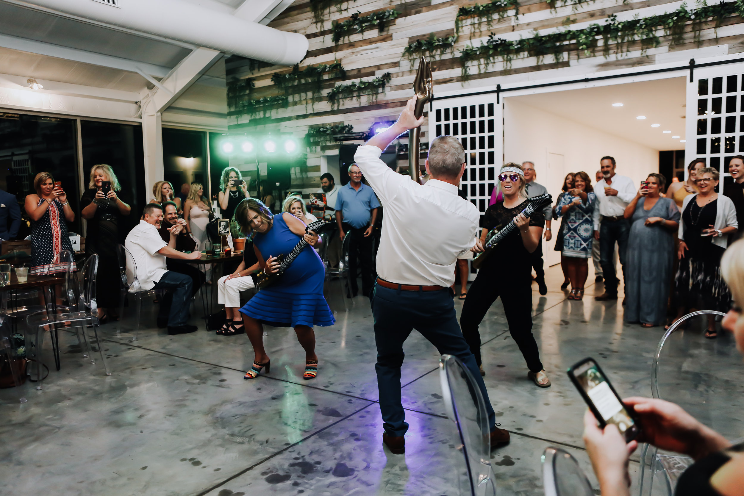 Father-daughter dance with a twist 4 . Entire family dances with Natalee at her Greenhouse Two Rivers Wedding. - Wedding Planning with Unions With Celia