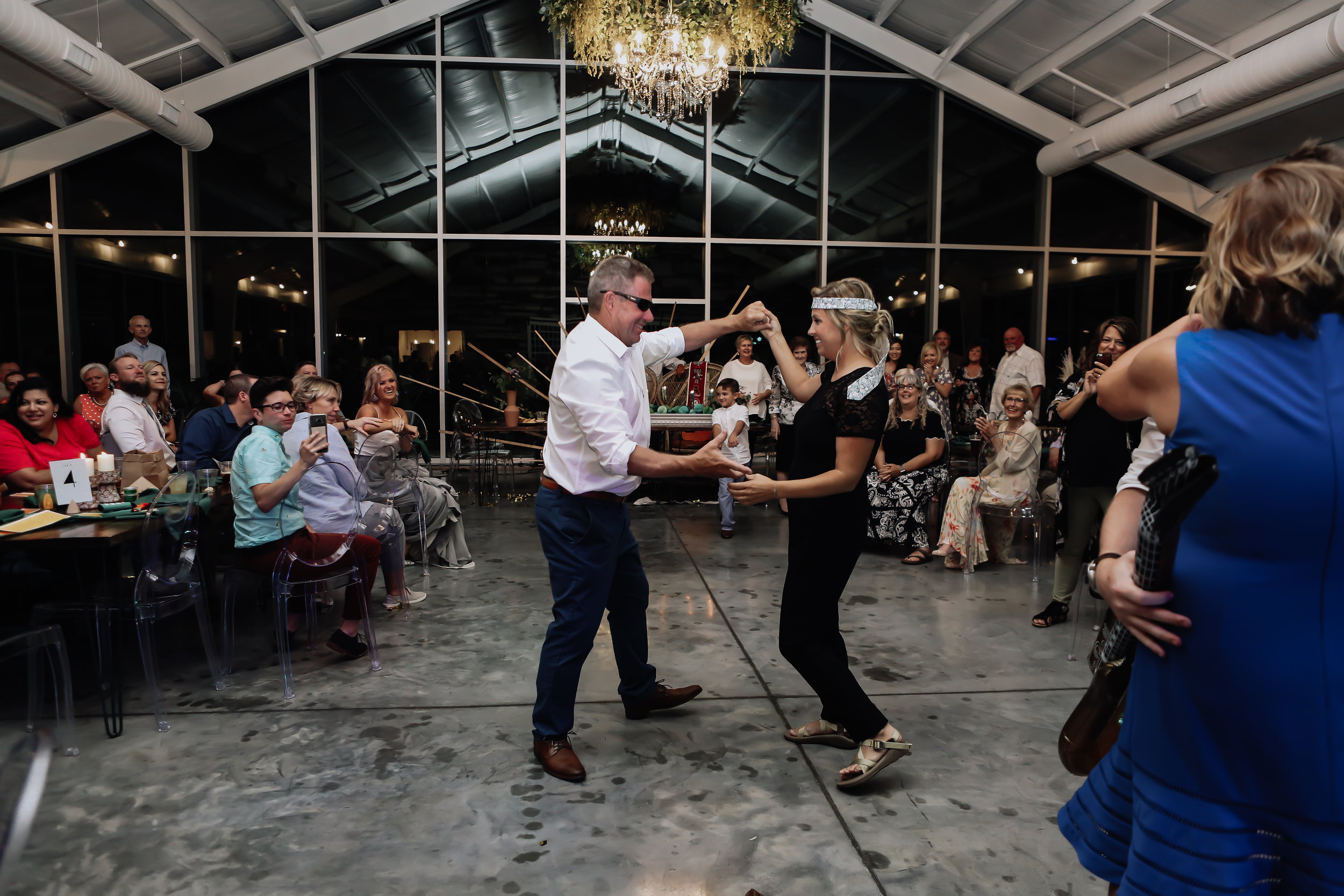 Father-daughter dance with a twist 7 . Entire family dances with Natalee at her Greenhouse Two Rivers Wedding. - Wedding Planning with Unions With Celia