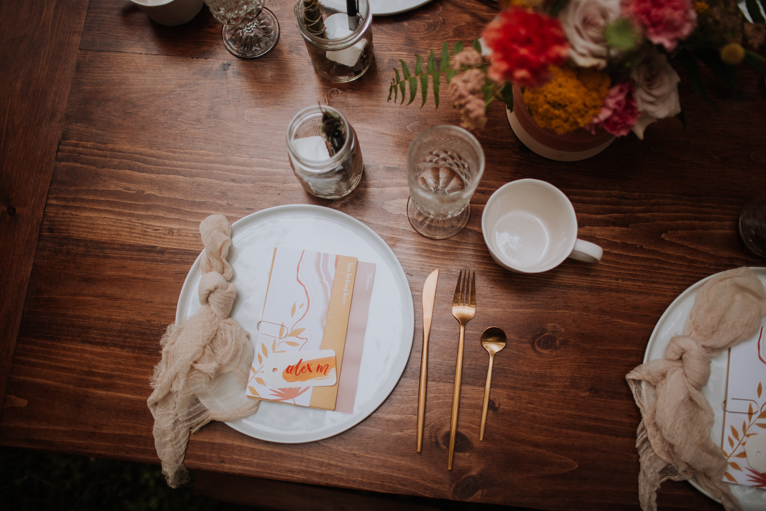 Attendees of Gather Midwest were greeted by a beautiful, personalized place setting that included a packet of information, intentional prompts, note pages, a print to take home, and gifts from our wonderful sponsors.