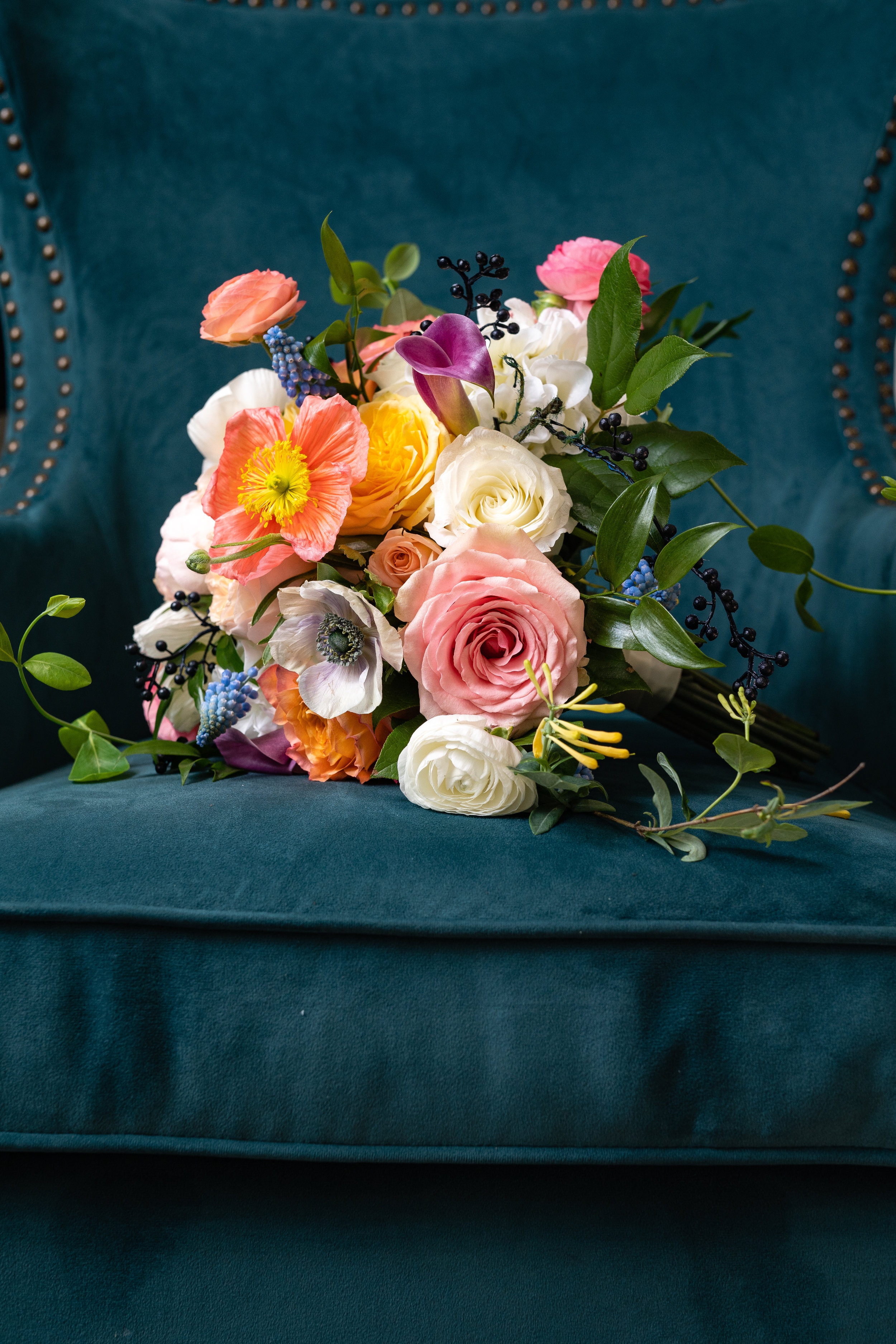 A colorful floral bouquet is perfect for a vintage inspired non-traditional wedding. These blooms are designed by The Flower Merchant in Springfield, MO.