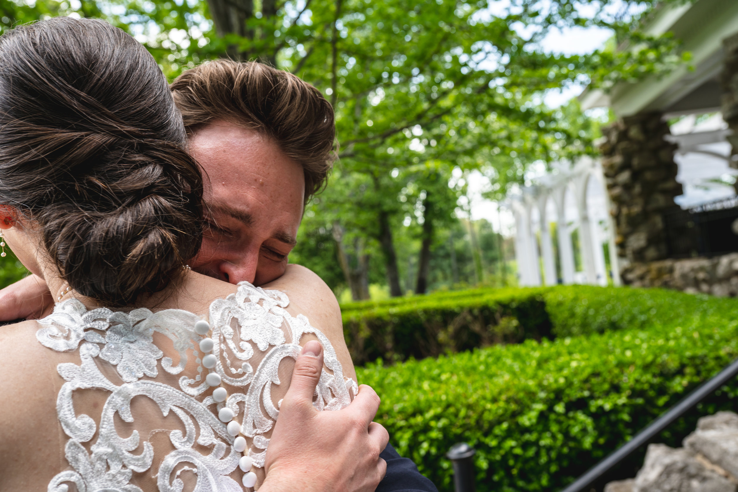 This emotional first look between the couple was a special moment on their intentional wedding day. This first look was coordinated by the talented photographer and creative wedding planner at Haseltine Estate in Springfield, Missouri.