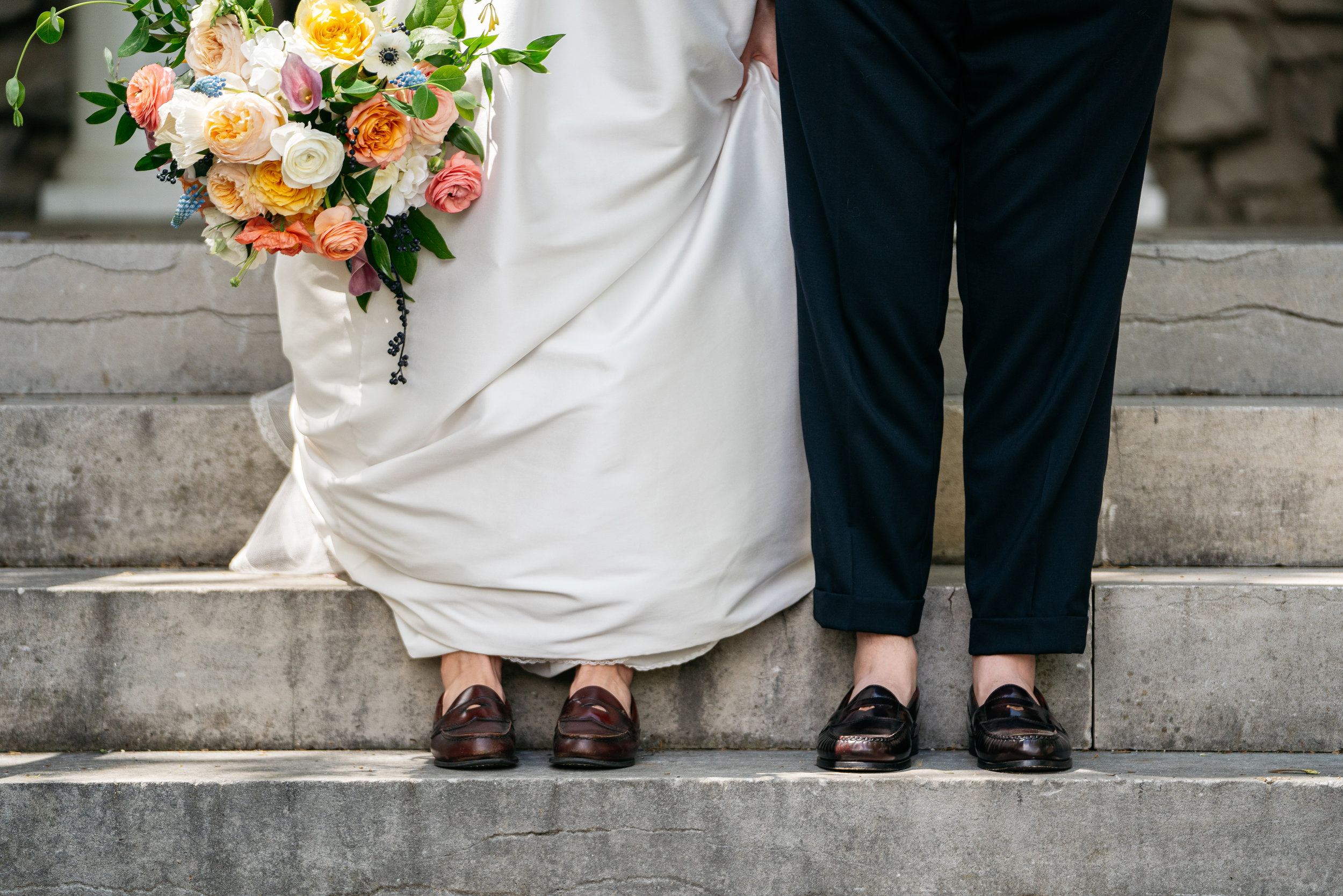 The couple wore matching shoes to their wedding. With encouragement from their wedding planner to make their day their own, they chose vintage penny loafers that are meaningful to both of them.
