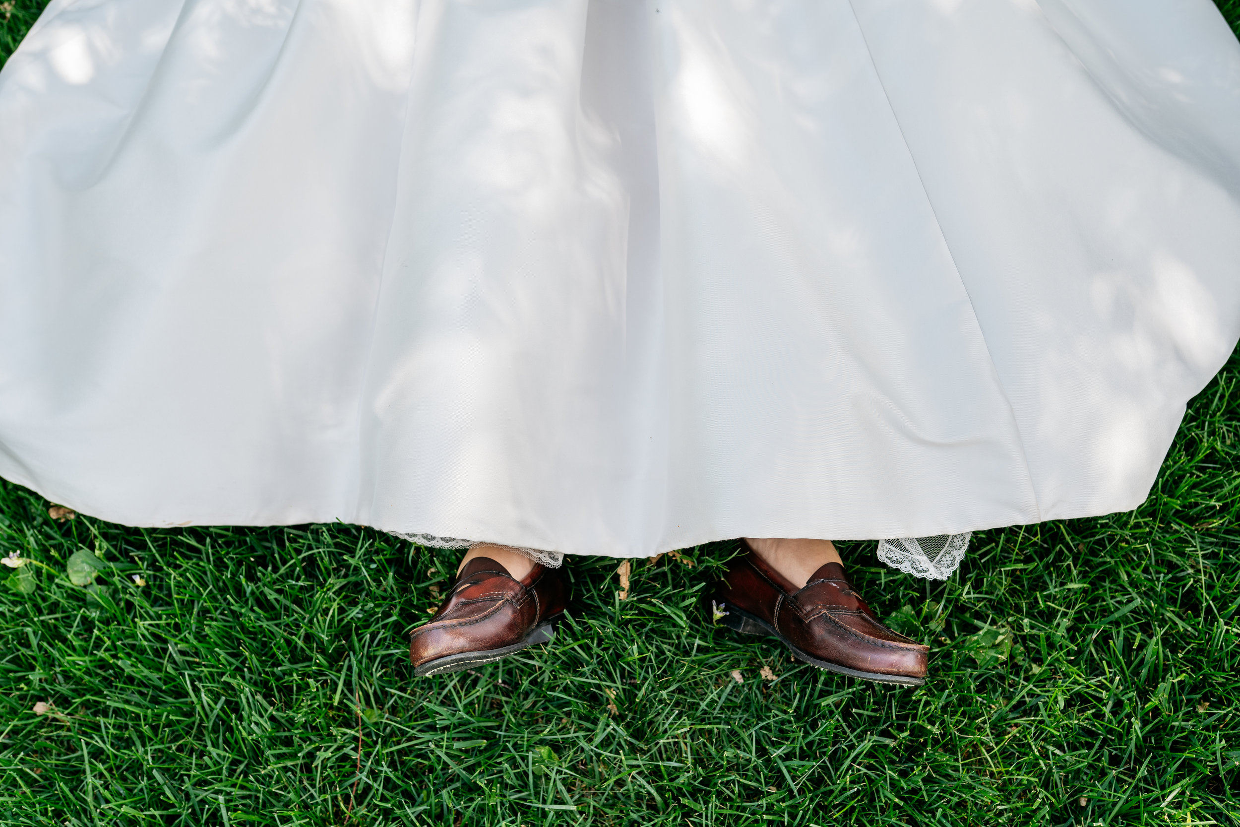 Here the bride wears penny loafers with her elegant gown. The couple take a few minutes alone to soak in their marriage on their wedding day by having a private picnic before joining their guests. Their wedding planner encouraged them to take as much time as they needed privately to celebrate and soak it in, your wedding day only happens once—make it memorable and don't rush.