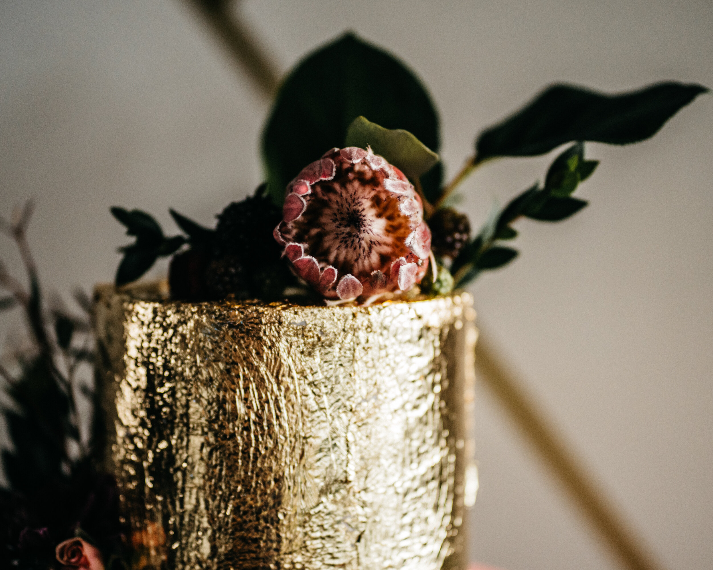Protea on a Gold Cake by Charity Fent Cake Design - Industrial Wedding Inspiration with Destination Wedding Planner Unions With Celia. Sean Reid Photography. Missouri Spirits.