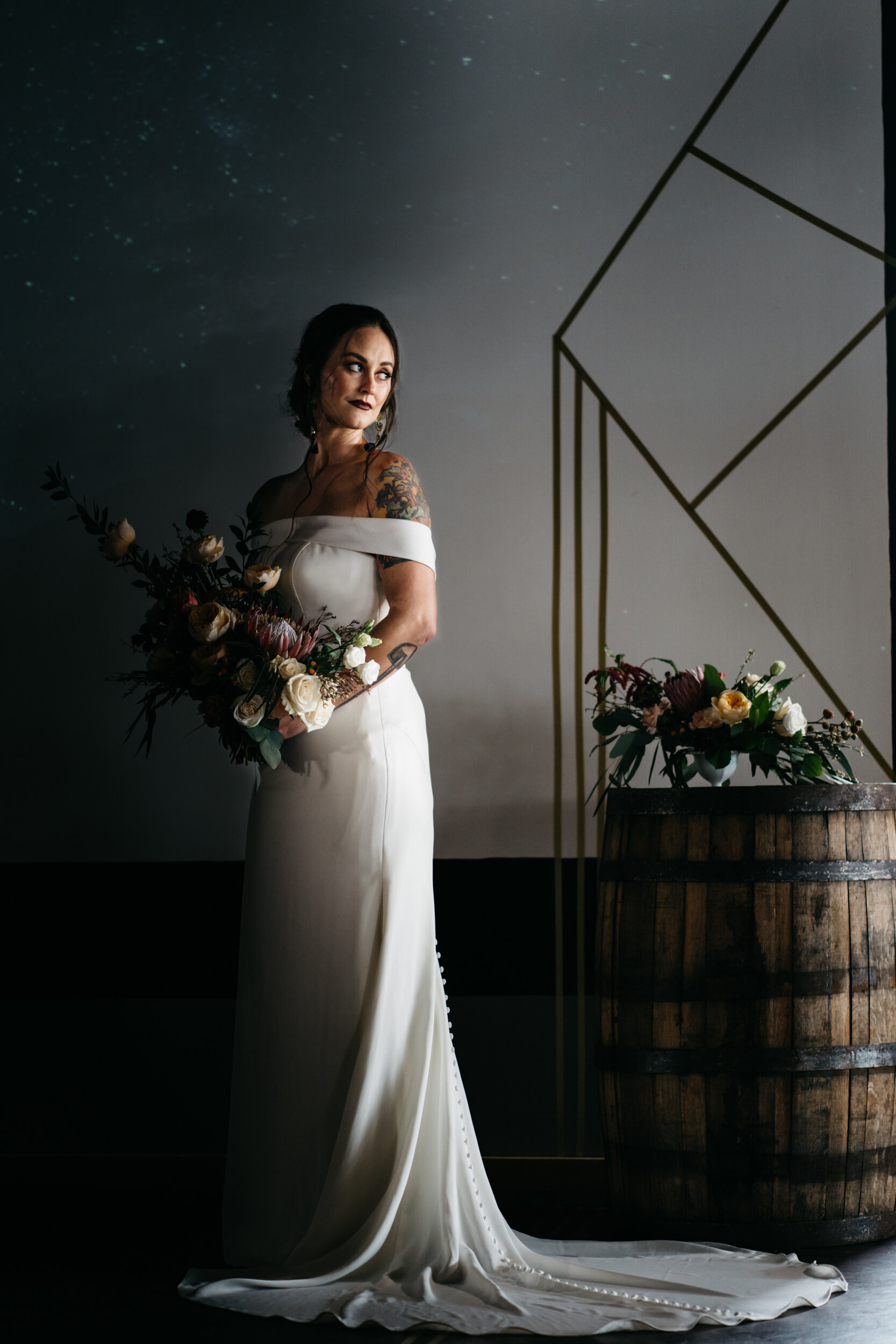 Bride wearing a Norman's Bridal Gown at Missouri Spirits with romantic oversized bouquet by Queen City Blooms - Industrial Wedding Inspiration with Destination Wedding Planner Unions With Celia and Destination Photographer Sean Reid Photography