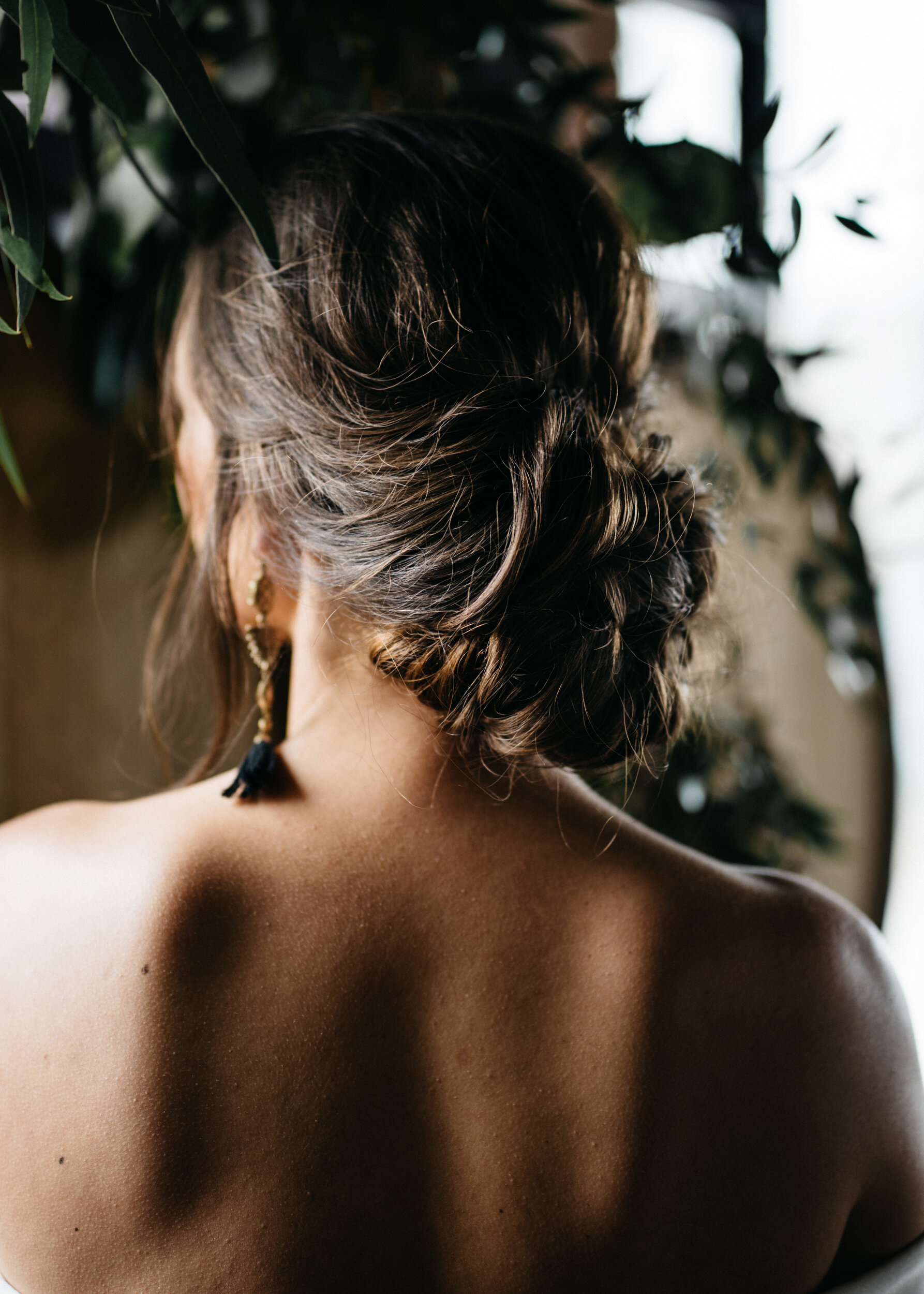 Long hair up-do by Leah Bailey at Missouri Spirts. Styled by creative wedding planner Unions With Celia. Photography by Sean Reid.