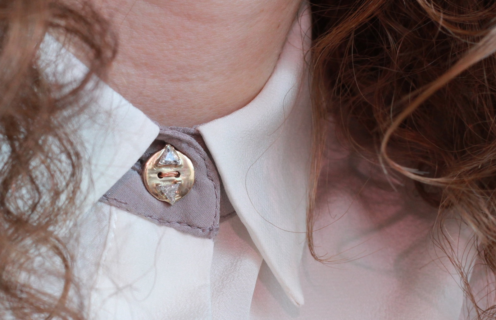Do It Anyway.  A diamond-encrusted gold shirt button made from my mother's wedding ring as a tribute to the quandary of emotional recklessness.