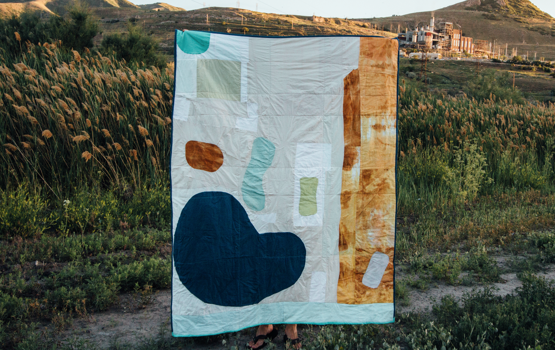 The  Romance of Mining Quilt  explores our illusion of control over our natural environment.
