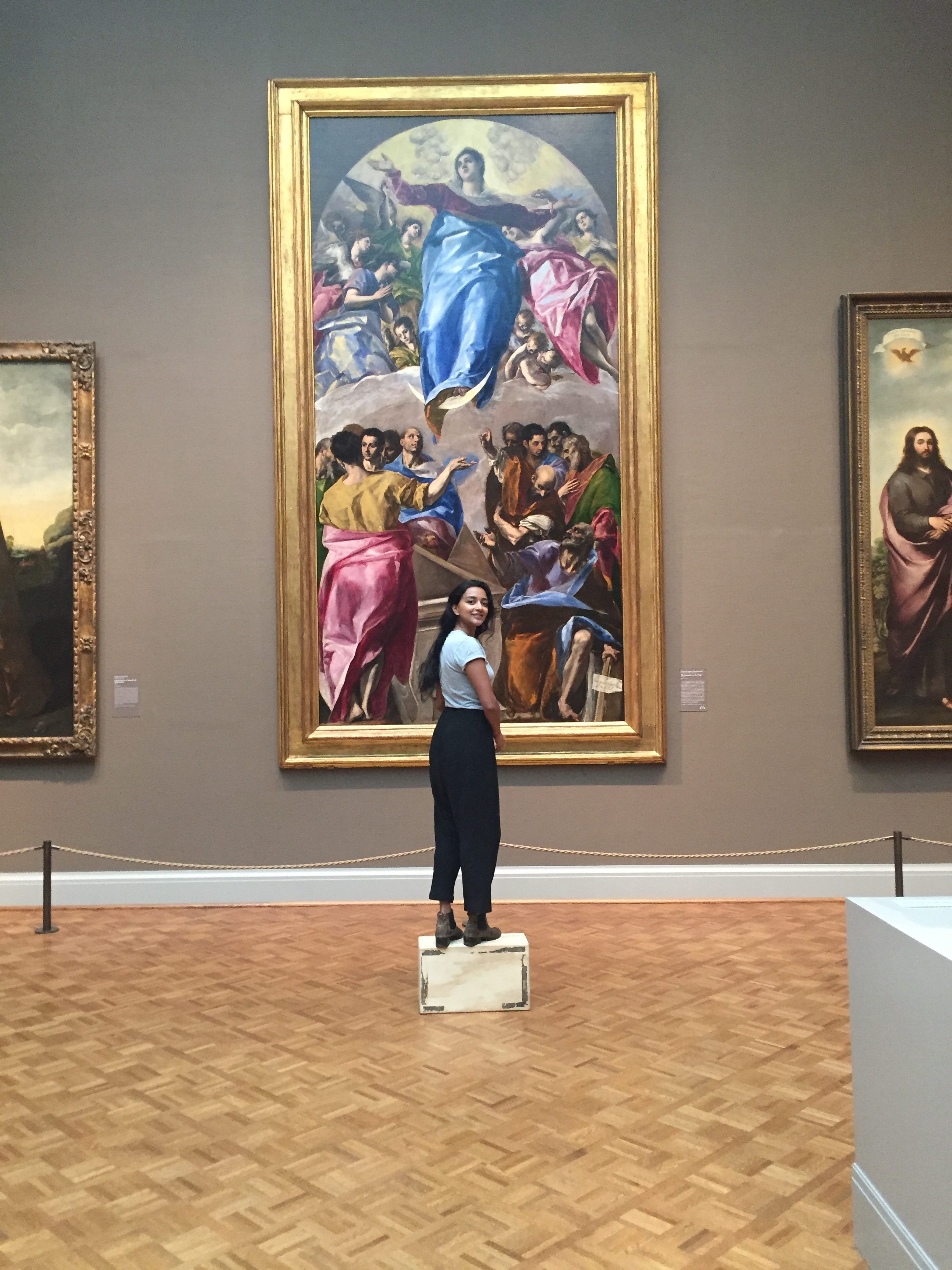 Tara, standing on a prop, to get a larger-than-life perspective in front of the painting.