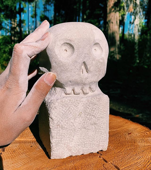 I went to stone carving camp and made more skeleton art, spooky dusty hand for scale