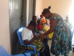 Ms. Gaa treating children at the nutrition center