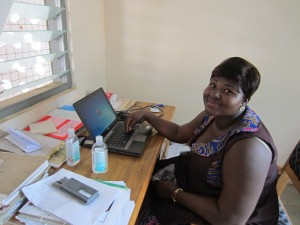 Ms. Gaa using the laptop computer recently donated to the Lawra Nutrition Center