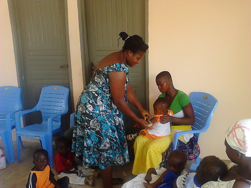 A child being measured at the nutrition center