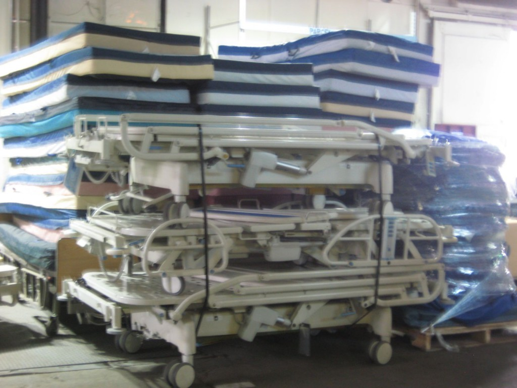 Hospital Beds Stacked for Loading