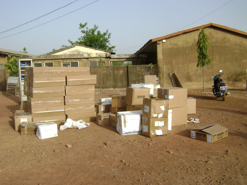 Boxes of Medical Supplies Being Unloaded