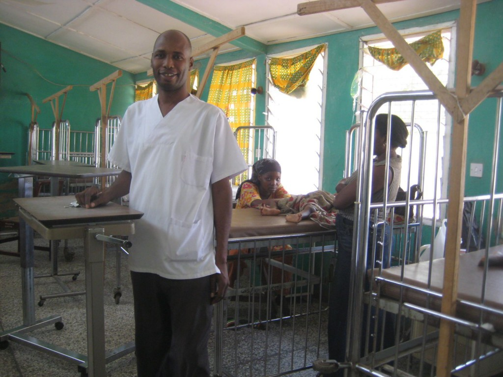 Dr. Abdulai with Donated Bedside Tables