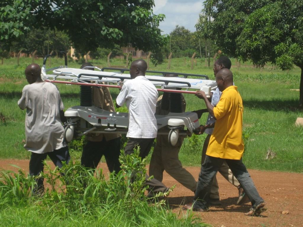 Carrying Hospital Beds into the Lawra District Hospital