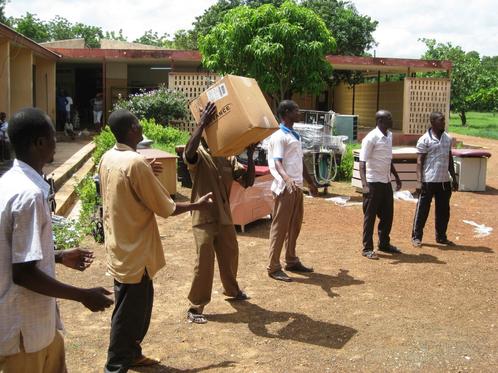 Community Members and Health Staff Working Together to Unload The Supplies