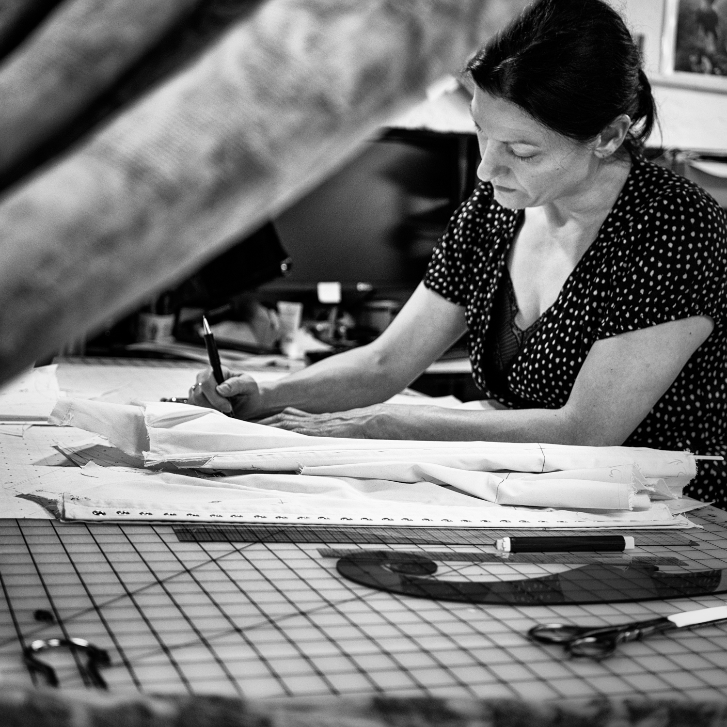 Our Process - Our dedication to quality is possible thanks to our unique on-site production process. Step behind the curtains of our boutique and you'll find our workroom, humming with the activity of our expert production team. This setup allows us the flexibility of an independent corsetiere with the reliability of full-scale manufacturing. We employ a team of five cutters, stitchers, and drafters who work closely together to fulfill Autumn's visions of small-batch corsetry. Autumn remains intimately involved in the process of fitting bespoke corsets as well as prototyping new designs and construction techniques.