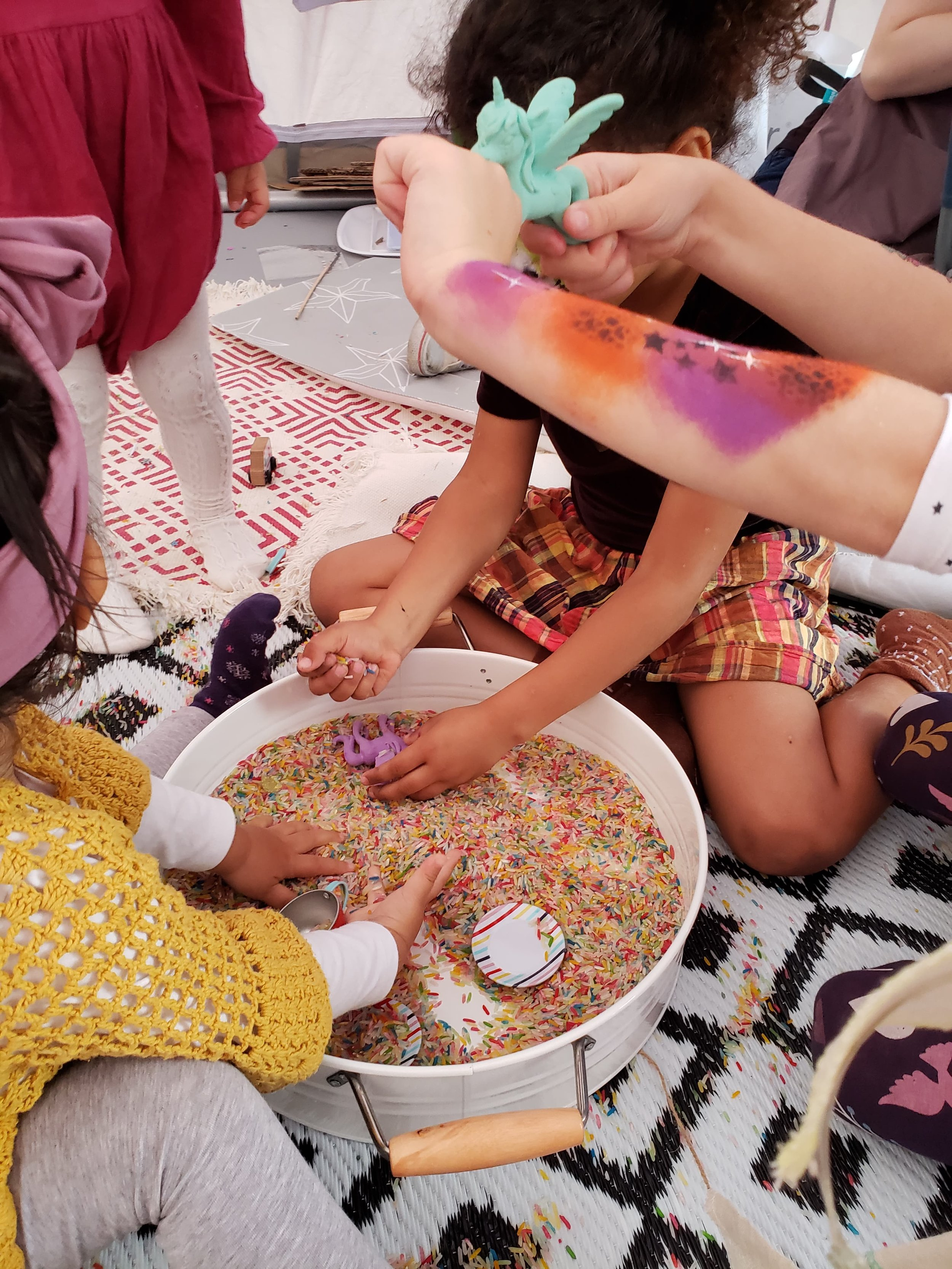 Sensory play engages ALL senses - Children learn best and are able to retain more information when all senses are engaged.During sensory play, the brain makes connections as they learn pre-math skills such as comparing size or volume (which cup can hold more rainbow rice). They also build on science skills such as gravity (the rice goes down the funnel when I pour it) and cause and effect (what happens when I squish rainbow rice vs. squishing playdough?).Children exercise their creativity and imagination as sensory play provides open-ended learning opportunities. This prompts kids to think creatively to solve problems or to engage in make believe scenarios while they are at play.Sensory play activities help children to use descriptive and expressive language, as they experience the true meaning of the word: grainy, loose.Sensory play activities strengthens fine motor skills and develops pre-writing skills as they pour, spoon, mix, scoop, measure, grasp and squish.Sensory play activities allow children to be in complete control of their actions and experiences. This in turn inspires them to learn and experiment. It also boosts their confidence in decision making.